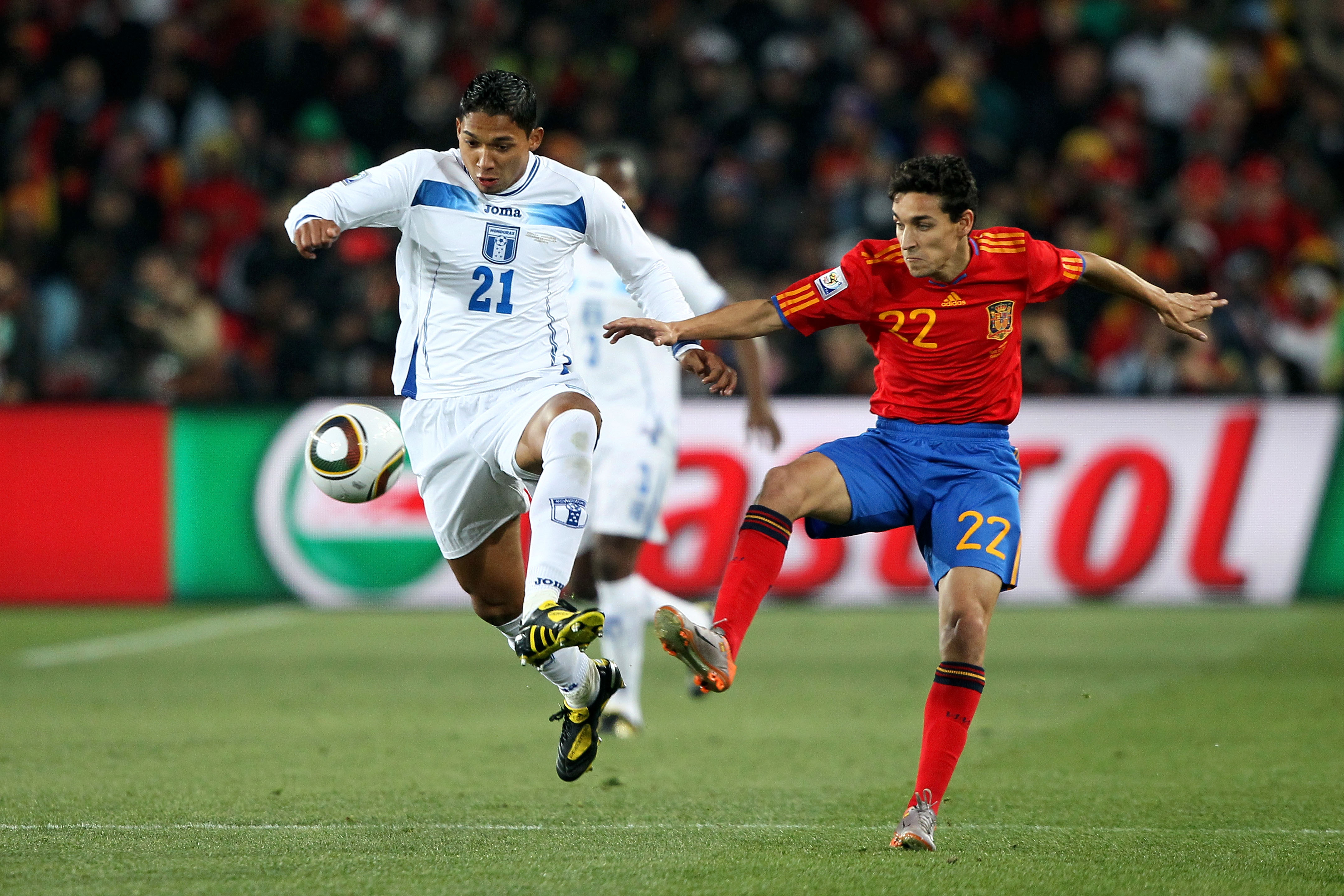 JOHANNESBURG, SOUTH AFRICA - JUNE 21:  Emilio Izaguirre of Honduras and Jesus Navas of Spain battle for the ball during the 2010 FIFA World Cup South Africa Group H match between Spain and Honduras at Ellis Park Stadium on June 21, 2010 in Johannesburg, S