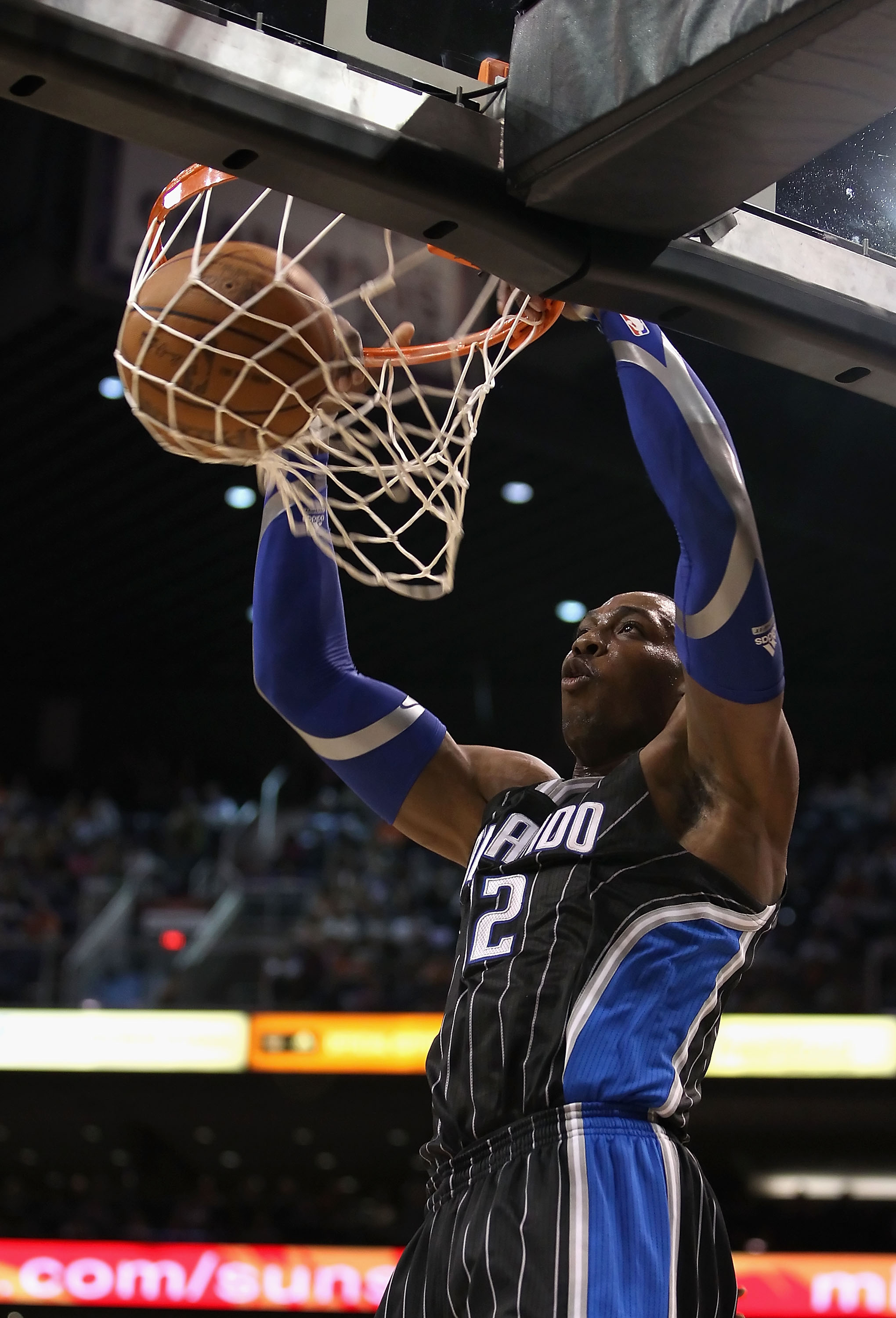 PHOENIX, AZ - MARCH 13:  Dwight Howard #12 of the Orlando Magic slam dunks the ball against the Phoenix Suns during the NBA game at US Airways Center on March 13, 2011 in Phoenix, Arizona.  NOTE TO USER: User expressly acknowledges and agrees that, by dow