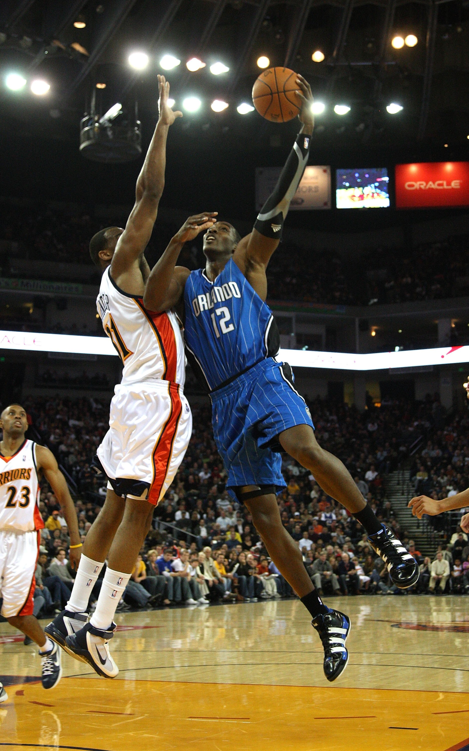 OAKLAND, CA - DECEMBER 05:  Dwight Howard #12 of the Orlando Magic in action against the Golden State Warriors during an NBA game at Oracle Arena on December 5, 2009 in Oakland, California. NOTE TO USER: User expressly acknowledges and agrees that, by dow