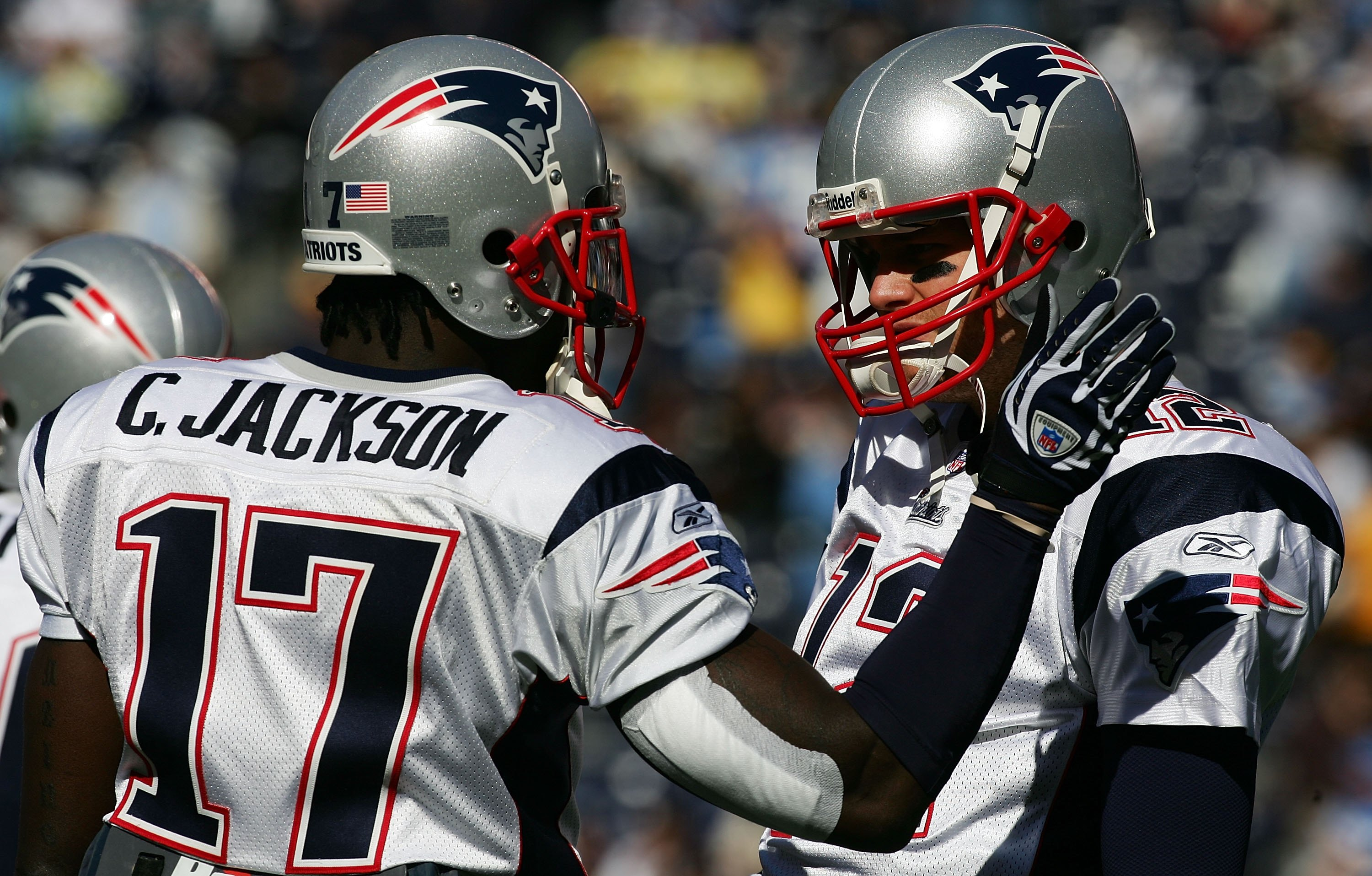 SAN DIEGO - JANUARY 14:  (R-L) Quarterback Tom Brady #12 of the New England Patriots talks with wide receiver Chad Jackson #17 before the game against the San Diego Chargers during the AFC Divisional Playoffs held on January 14, 2007 at Qualcomm Stadium i