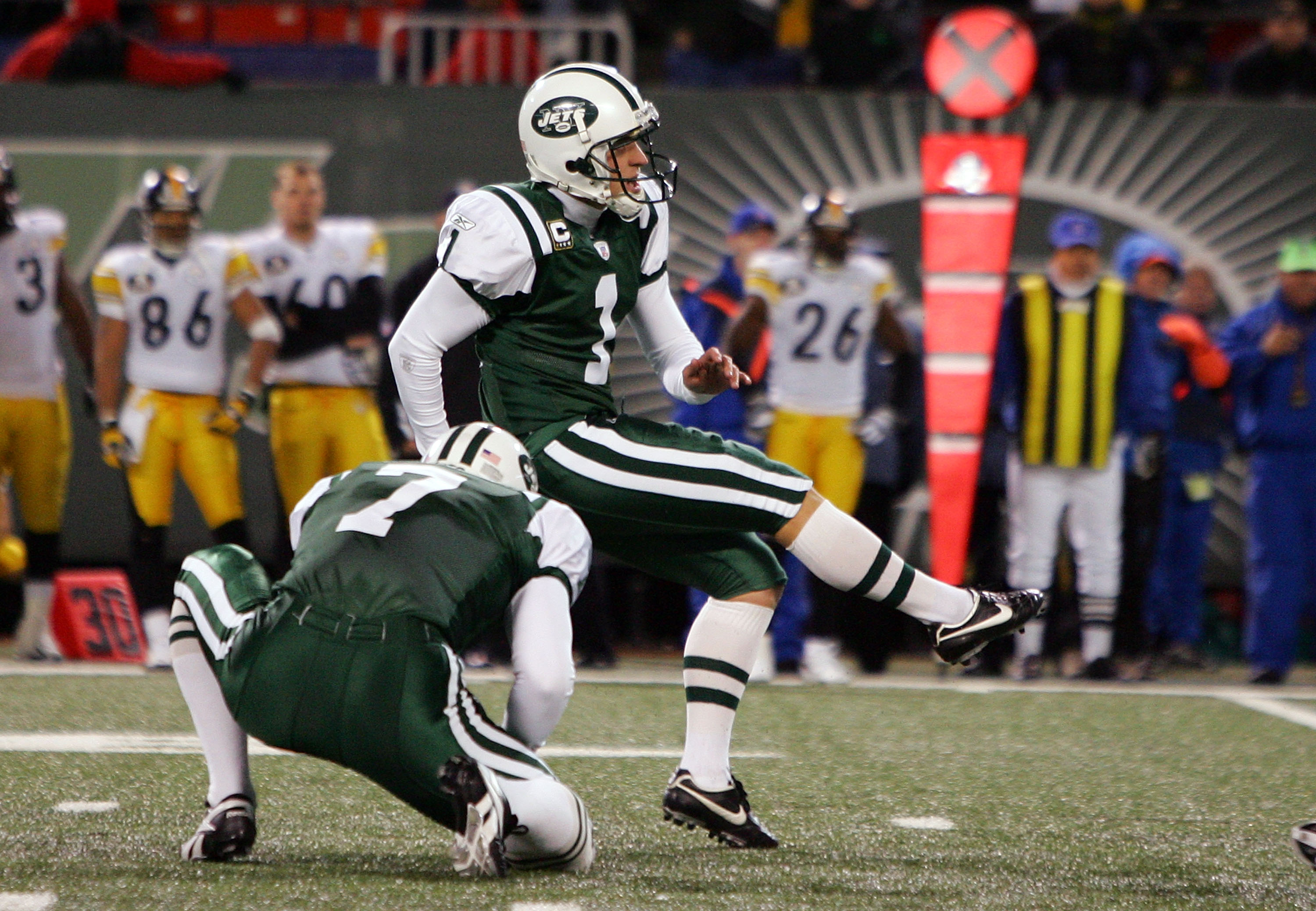 EAST RUTHERFORD, NJ - NOVEMBER 18:  Mike Nugent #1 of the New York Jets kicks the game-winning field goal against the Pittsburgh Steelers at Giants Stadium November 18, 2007 in East Rutherford, New Jersey. The Jets defeated the Steelers 19-16 in overtime.