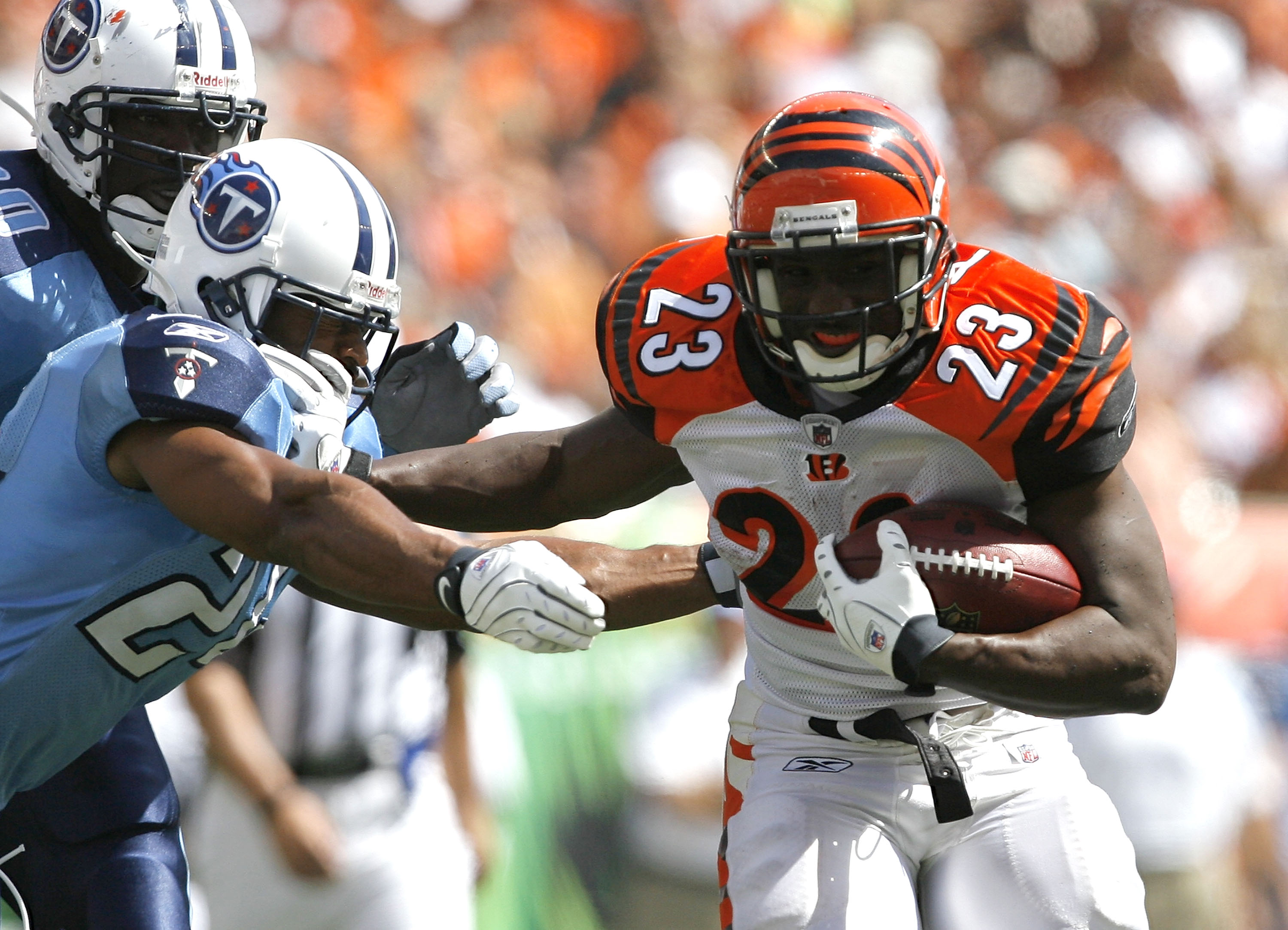 CINCINNATI - SEPTEMBER 14: Chris Perry #23 of the Cincinnati Bengals runs by Chris Hope #24 of the Tennessee Titans during the second quarter of their NFL game September 14, 2008 at Paul Brown Stadium in Cincinnati, Ohio. The Titans defeated the Bengals 2