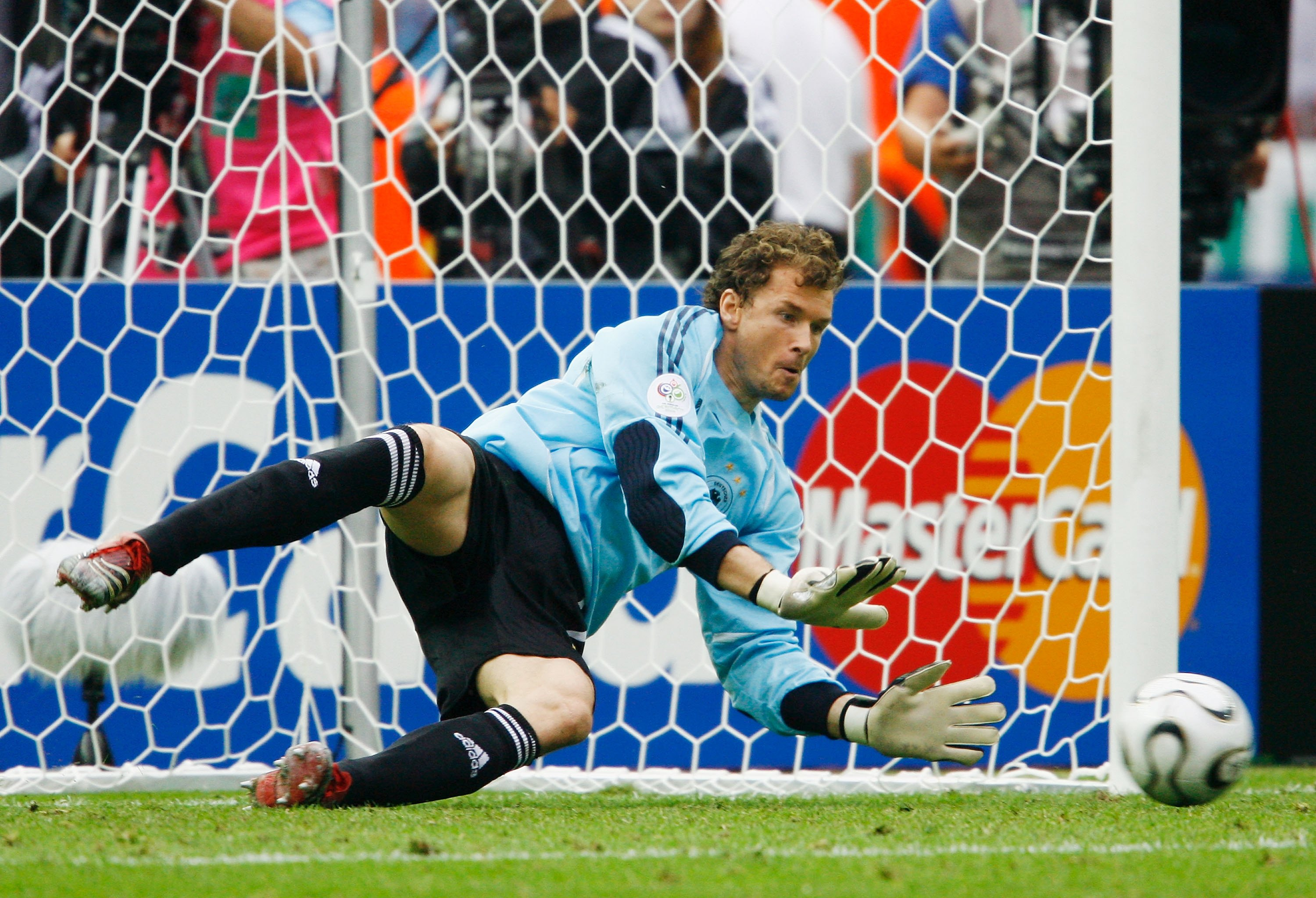 BERLIN - JUNE 30:  Jens Lehmann of Germany dives to save a penalty taken by Roberto Ayala of Argentina in a penalty shootout during the FIFA World Cup Germany 2006 Quarter-final match between Germany and Argentina played at the Olympic Stadium on June 30,