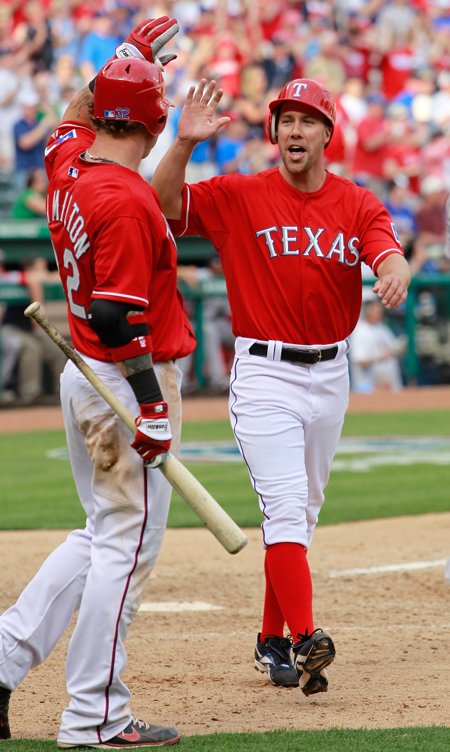 ARLINGTON, TX - APRIL 01:  David Murphy #7 of the Texas Rangers celebrates with Josh Hamilton #32 of the Texas Rangers after Hamilton hit the game winning RBI double in the bottom of the eighth inning against the Boston Red Sox on Opening Day at Rangers B