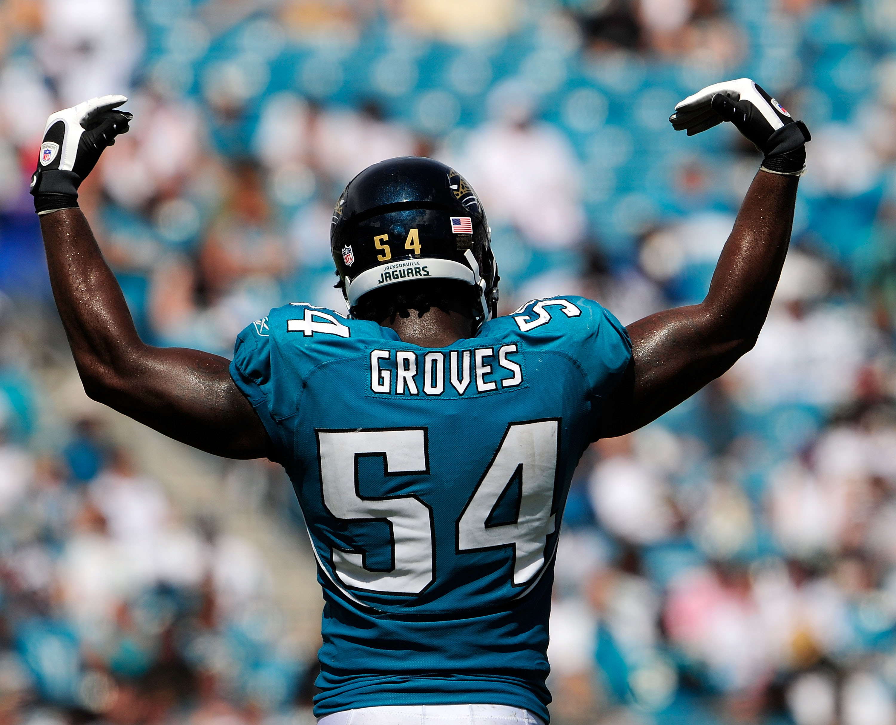 JACKSONVILLE, FL - SEPTEMBER 20:  Quentin Groves #54 of the Jacksonville Jaguars asks the crowd for noise during the game against the Arizona Cardinals at Jacksonville Municipal Stadium on September 20, 2009 in Jacksonville, Florida.  (Photo by Sam Greenw