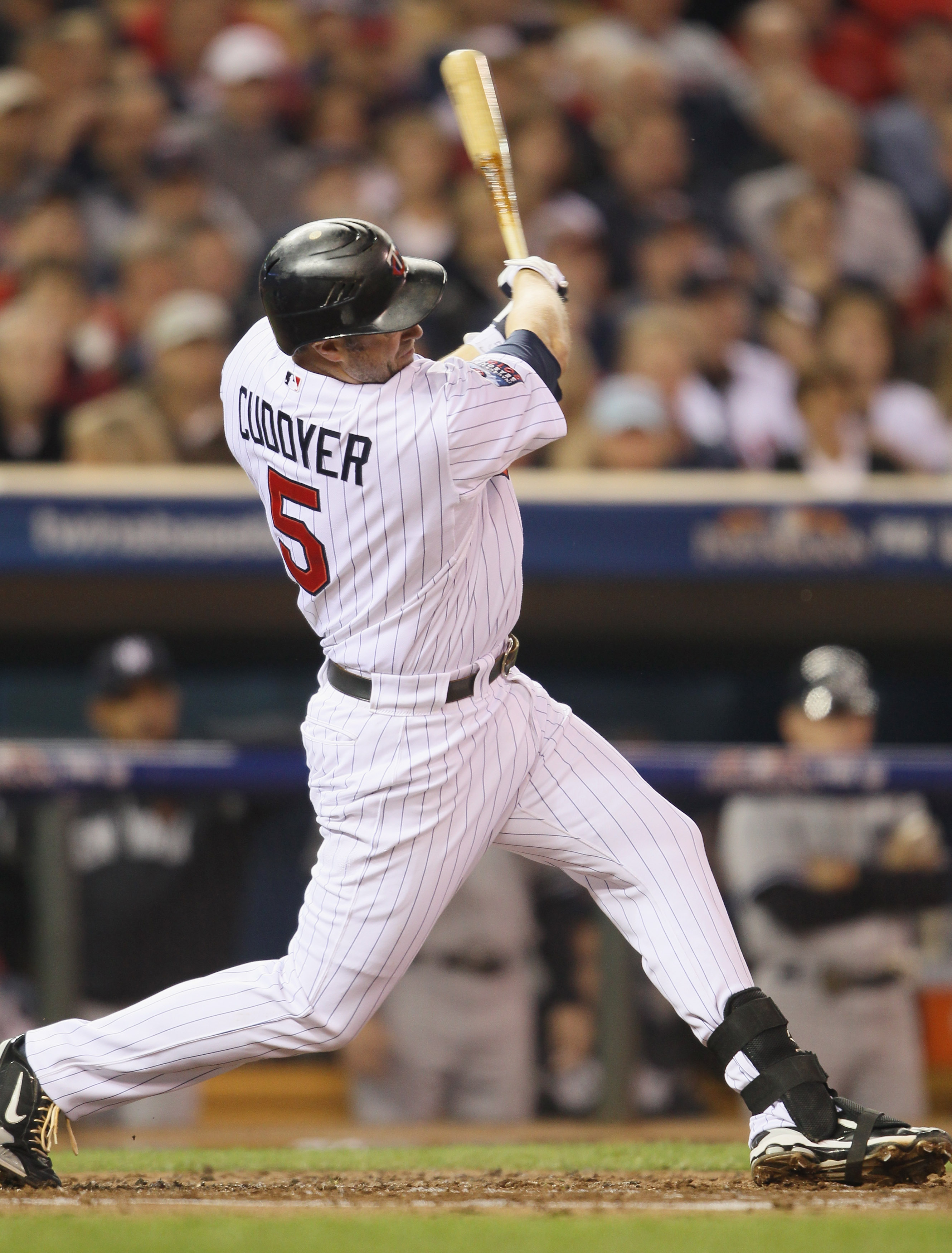 MINNEAPOLIS - OCTOBER 06:  Michael Cuddyer #5 of the Minnesota Twins hits a two run homer in the second inning against the New York Yankees during game one of the ALDS on October 6, 2010 at Target Field in Minneapolis, Minnesota.  (Photo by Elsa/Getty Ima