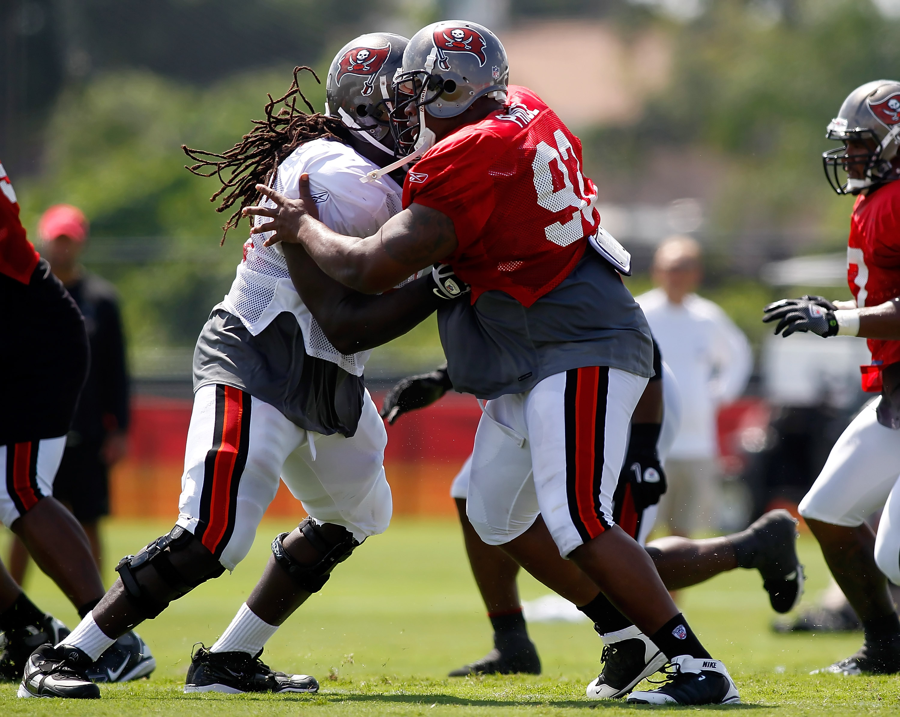 TAMPA - JULY 31:  Defensive tackle Brian Price #92 of the Tampa Bay Buccaneers works against offensive lineman Davin Joseph #75 during training camp at One Buccaneer Place on July 31, 2010 in Tampa, Florida.  (Photo by J. Meric/Getty Images)