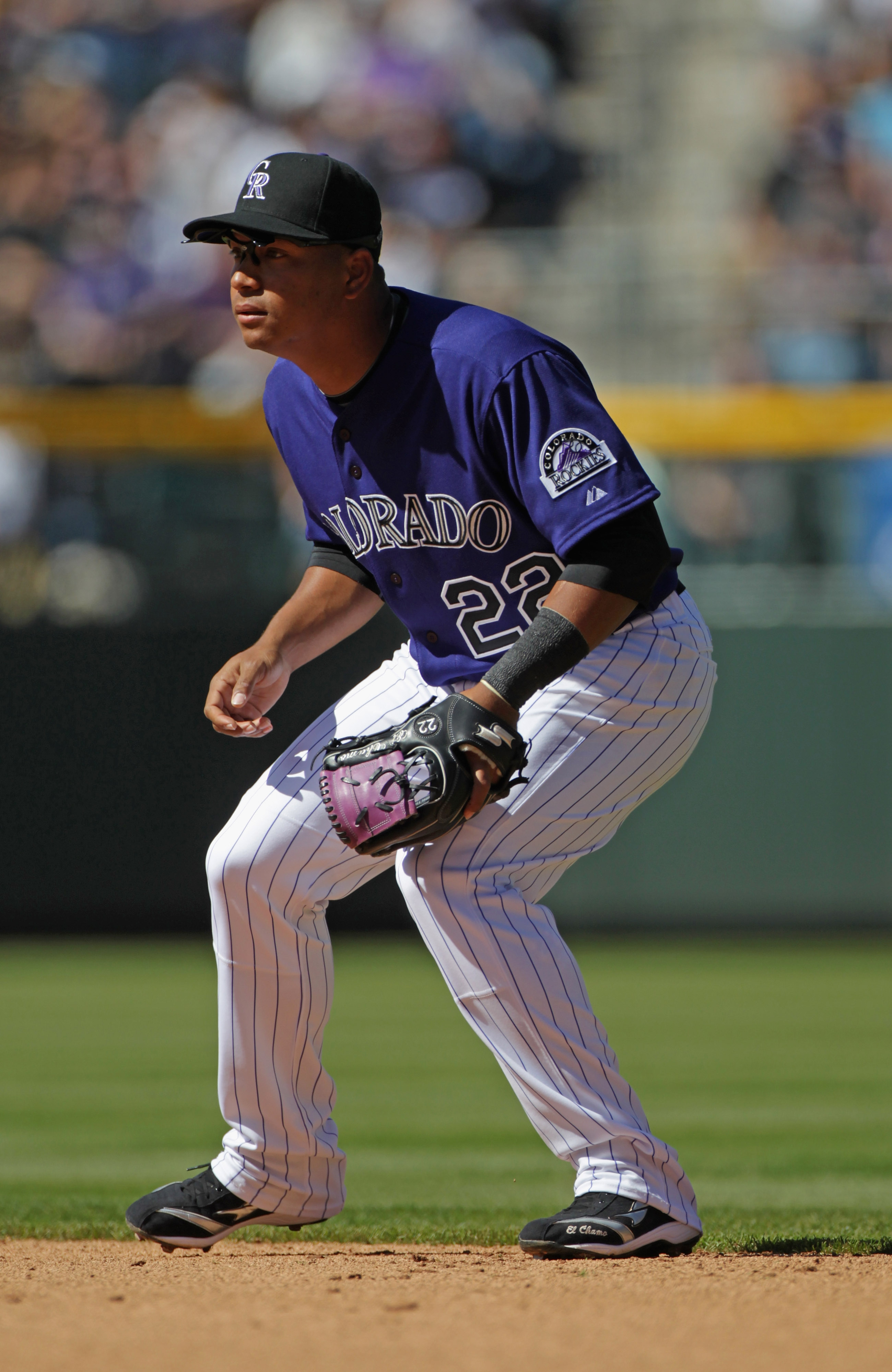 DENVER, CO - APRIL 01:  Second baseman Jose Lopez #22 of the Colorado Rockies plays defense against the Arizona Diamondbacks during Opening Day at Coors Field on April 1, 2011 in Denver, Colorado.  (Photo by Doug Pensinger/Getty Images)