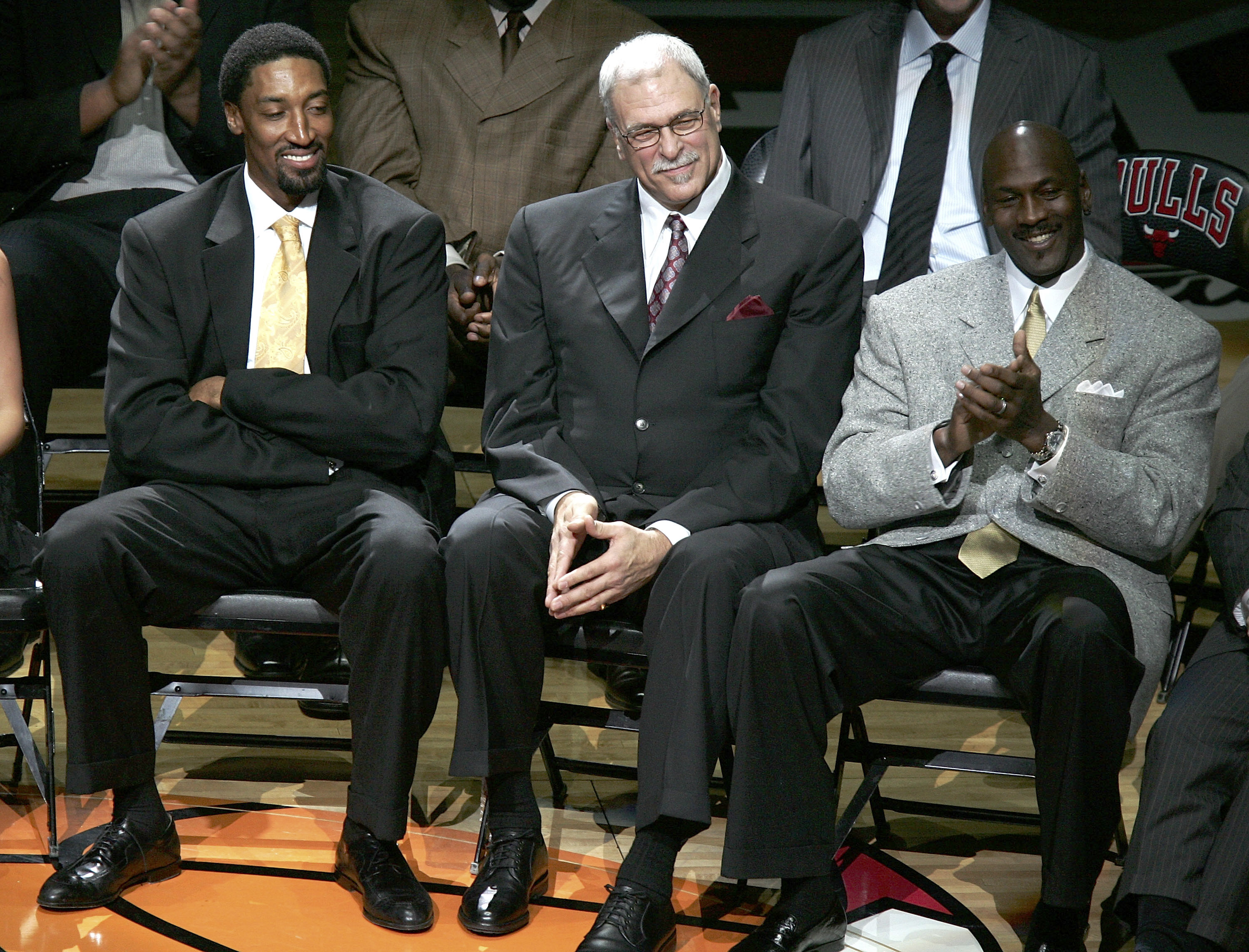 CHICAGO - DECEMBER 9:  (L-R) Scottie Pippen, Phil Jackson and Michael Jordan, formerly of the Chicago Bulls, look on during a ceremony retiring Pippen's #33 at halftime of a game between the Bulls and the Los Angeles Lakers on December 9, 2005 at the Unit