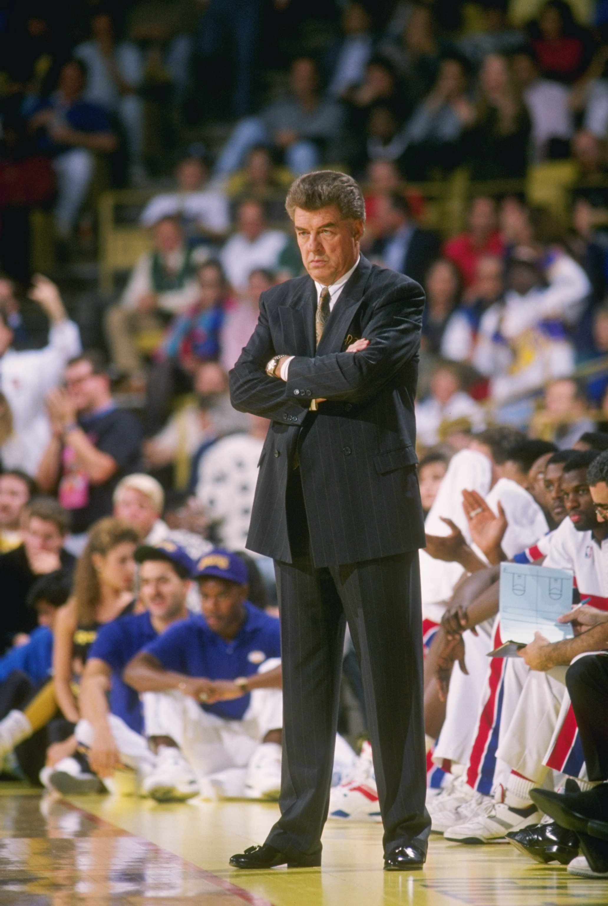 1989:  Head coach Chuck Daly of the Detroit Pistons stands on the sidelines during a game. Mandatory Credit: Mike Powell  /Allsport