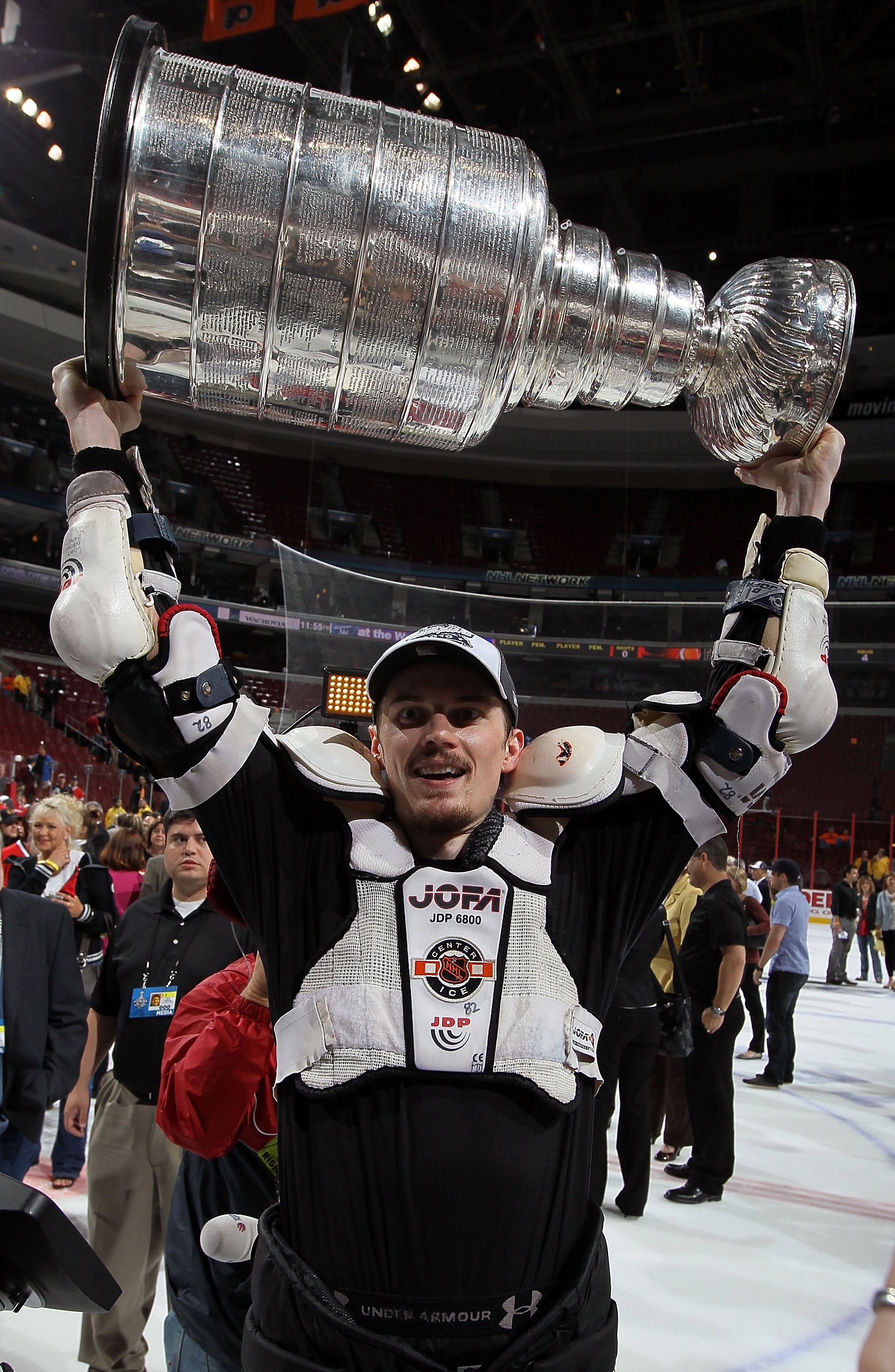 PHILADELPHIA - JUNE 09:  Tomas Kopecky #82 of the Chicago Blackhawks hoists the Stanley Cup after teammate Patrick Kane scored the game-winning goal in overtime to defeat the Philadelphia Flyers 4-3 and win the Stanley Cup in Game Six of the 2010 NHL Stan
