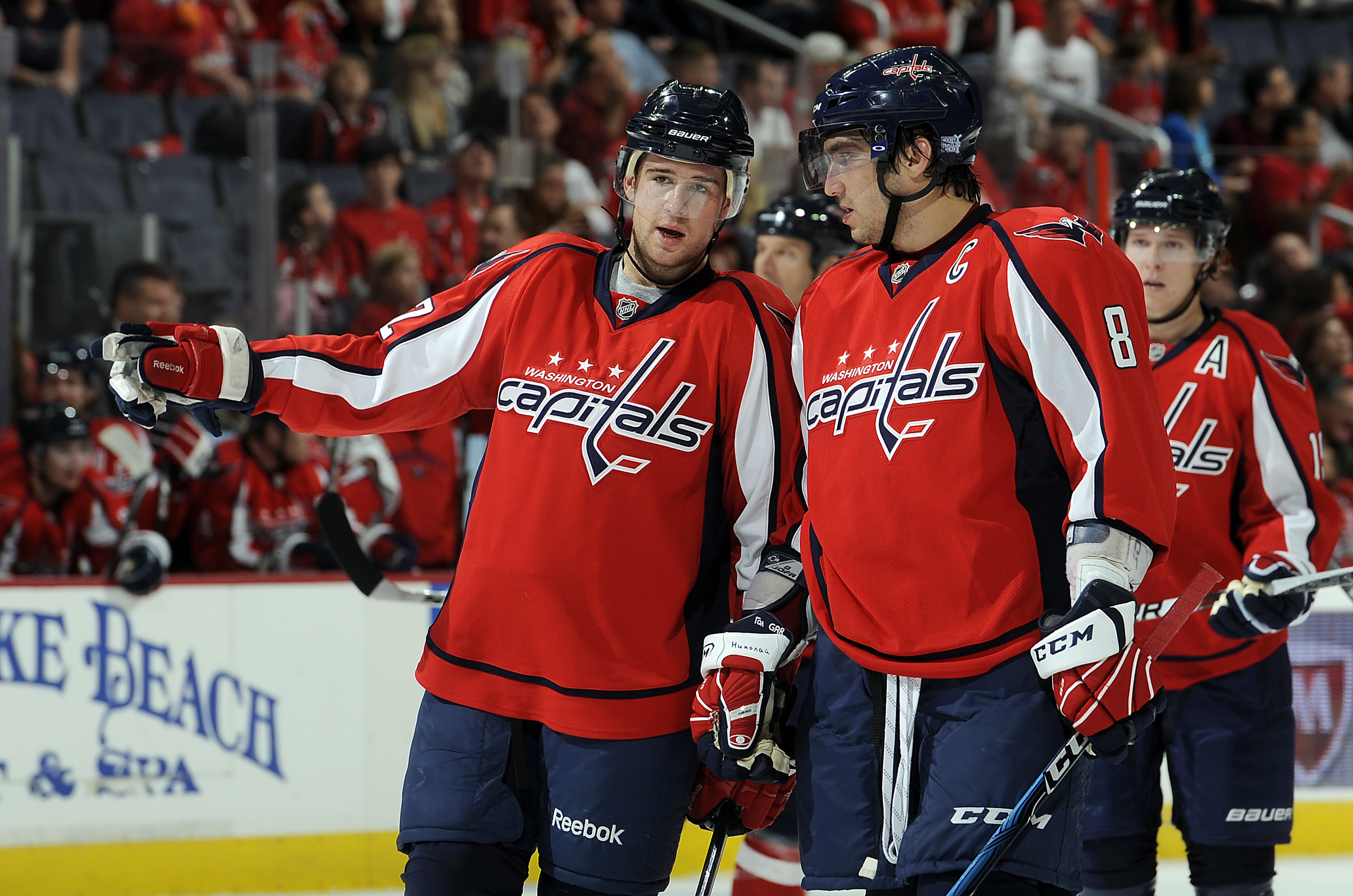 WASHINGTON - OCTOBER 11:  Mike Green #52 and Alex Ovechkin #8 of the Washington Capitals talk during the game against the Ottawa Senators at the Verizon Center on October 11, 2010 in Washington, DC.  (Photo by Greg Fiume/Getty Images)