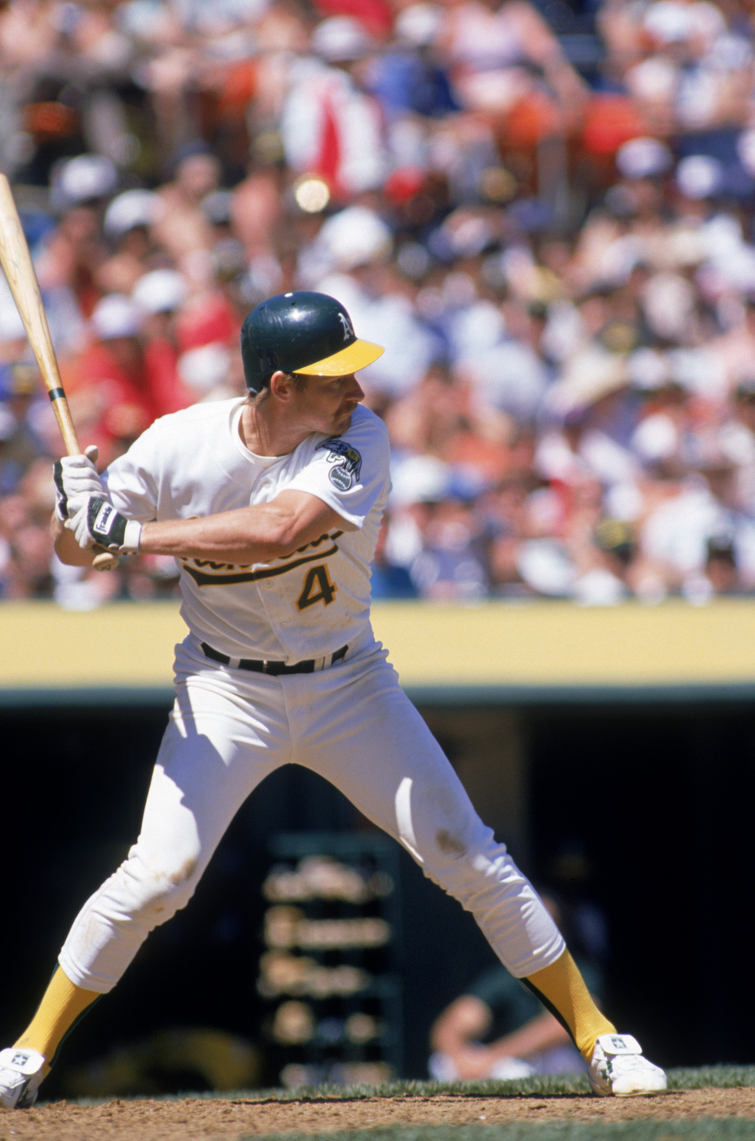 OAKLAND, CA - 1989:  Carney Lansford #4 of the Oakland Athletics stands ready at the plate during a 1989 season game at Oakland-Alameda County Coliseum in Oakland, California.  (Photo by Otto Greule Jr/Getty Images)