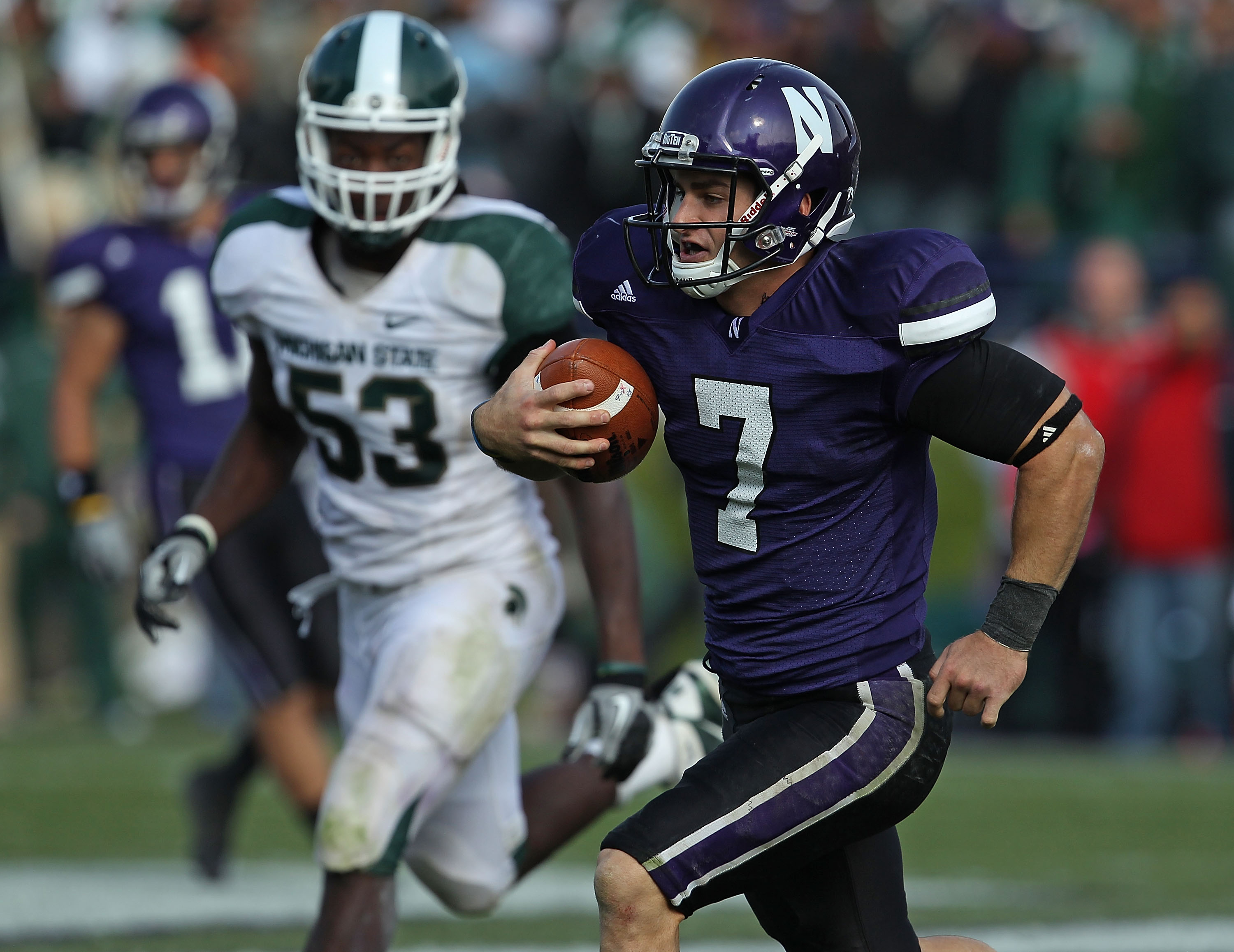 EVANSTON, IL - OCTOBER 23: Dan Persa #7 of the Northwestern Wildcats runs against the Michigan State Spartans pursued by Greg Jones #53 at Ryan Field on October 23, 2010 in Evanston, Illinois. Michigan State defeated Northwestern 35-27.  (Photo by Jonatha