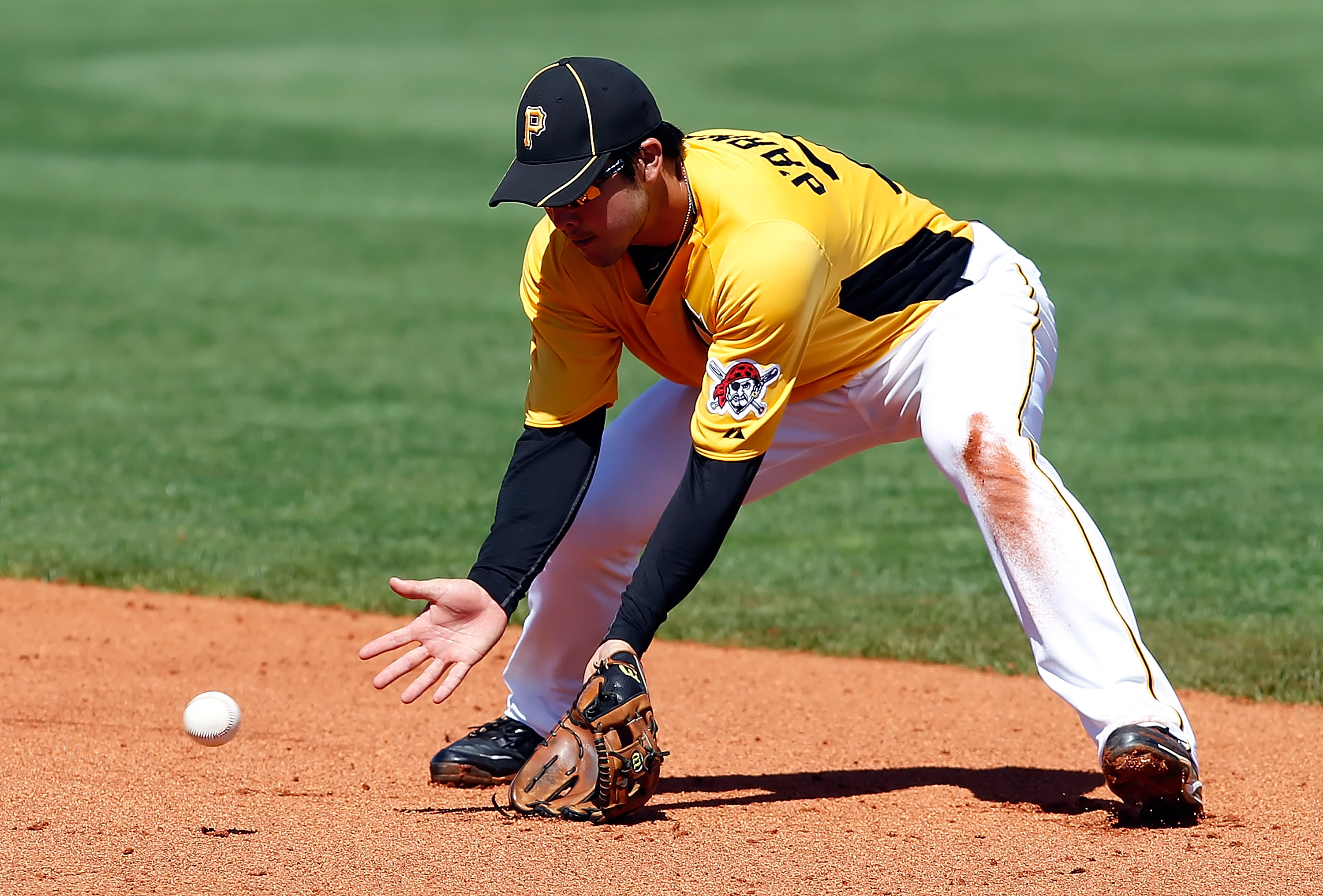 BRADENTON, FL - FEBRUARY 28:  Infielder Chase d'Arnaud #79 of the Pittsburgh Pirates fields a ground ball against the Baltimore Orioles during a Grapefruit League Spring Training Game at McKechnie Field on February 28, 2011 in Bradenton, Florida.  (Photo