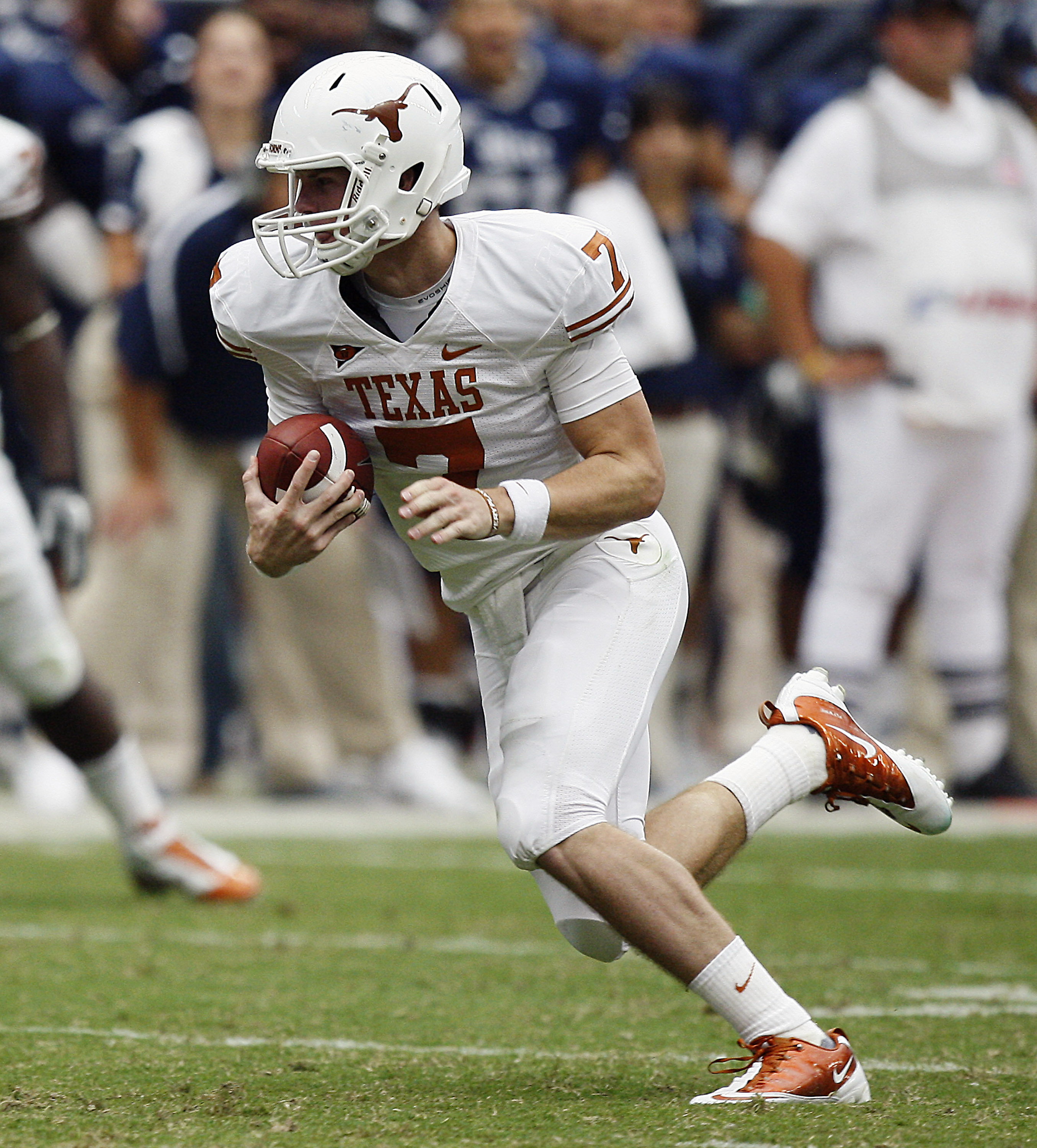 HOUSTON - SEPTEMBER 04:  Quarterback Garrett Gilbert #7 of the Texas Longhorns during game action against the Rice Owls at Reliant Stadium on September 4, 2010 in Houston, Texas. Texas won 34-17.  (Photo by Bob Levey/Getty Images)