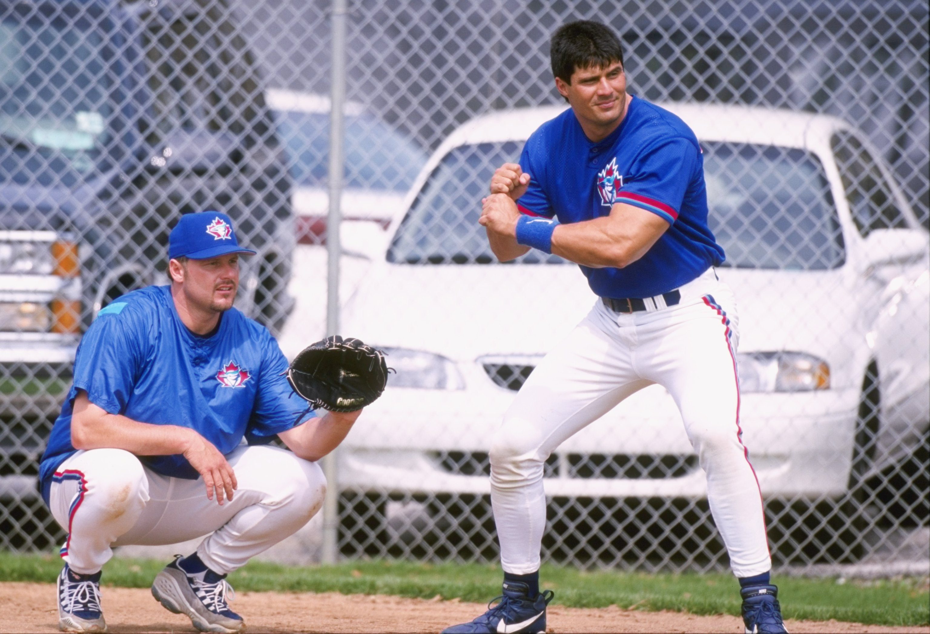 1 Mar 1998:  Jose Canseco #00 and Roger Clemens #21 of the Toronto Blue Jays play around after a spring training game against the Pittsburgh Pirates at the Dunedin Stadium in Dunedin, Florida. The Toronto Blue Jays beat the Pittsburgh Pirates 4-3. Mandato