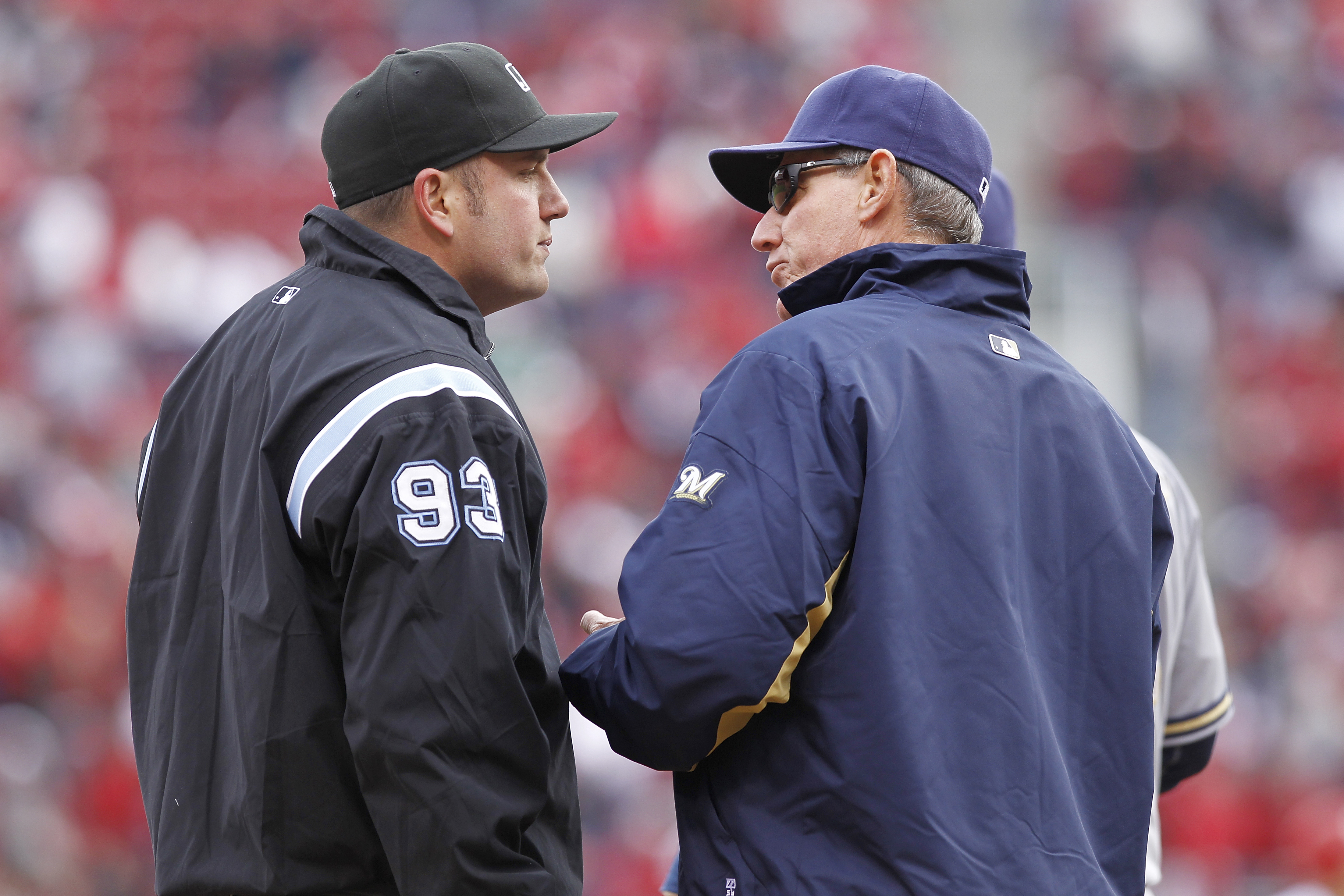 CINCINNATI, OH - MARCH 31: Milwaukee Brewers manager Ron Roenicke argues with third base umpire Dan Bellino after Casey McGehee missed a tag on Brandon Phillips of the Cincinnati Reds in the opening day game at Great American Ballpark on March 31, 2011 in