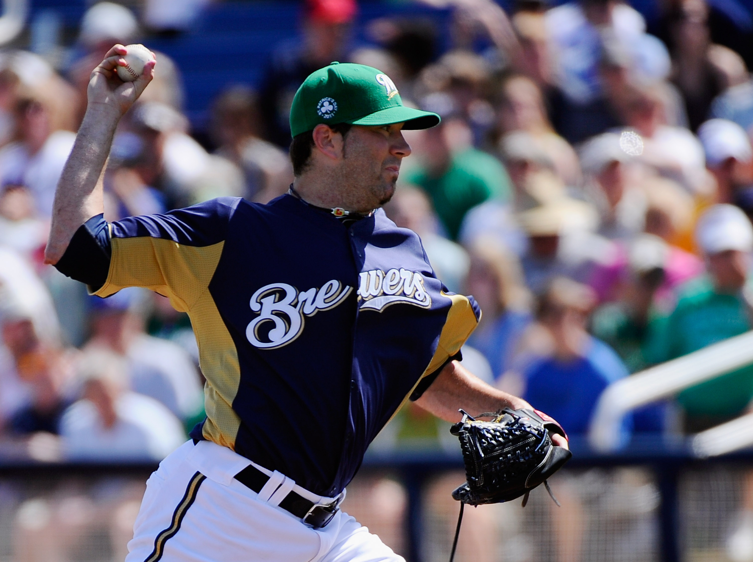 PHOENIX, AZ - MARCH 17:  Pitcher Shaun Marcum #18 of the Milwaukee Brewers throws a pitch against the Chicago White Sox during the first inning of the spring training game at Maryvale Baseball Park on March 17, 2011 in Phoenix, Arizona.  (Photo by Kevork