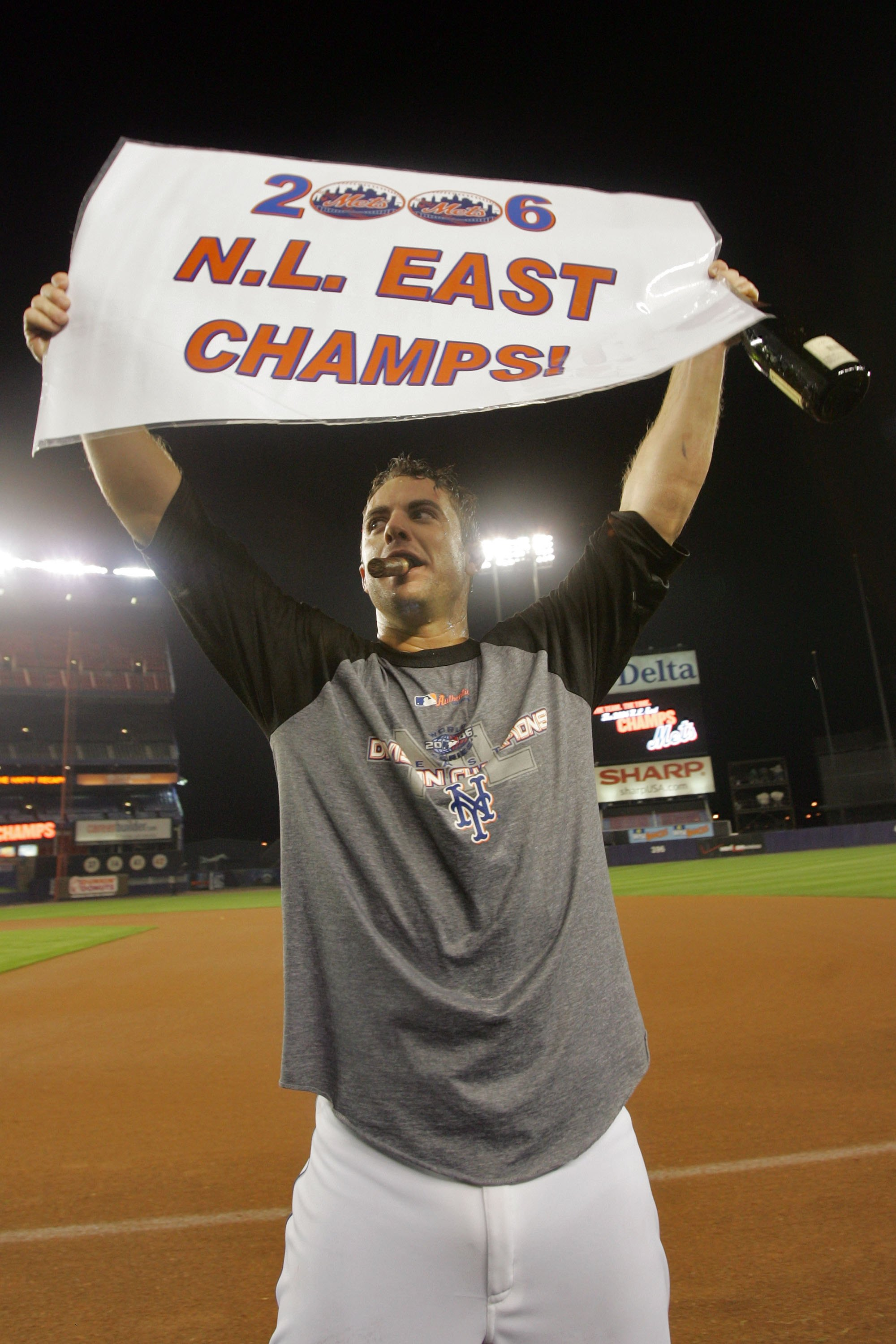 NEW YORK - SEPTEMBER 18:  David Wright #5 of the New York Mets holds up a sign reading '2006 N.L. East Champs' after beating the Florida Marlins on September 18, 2006 at Shea Stadium in the Flushing neighborhood of the Queens borough of New York City.  Wi