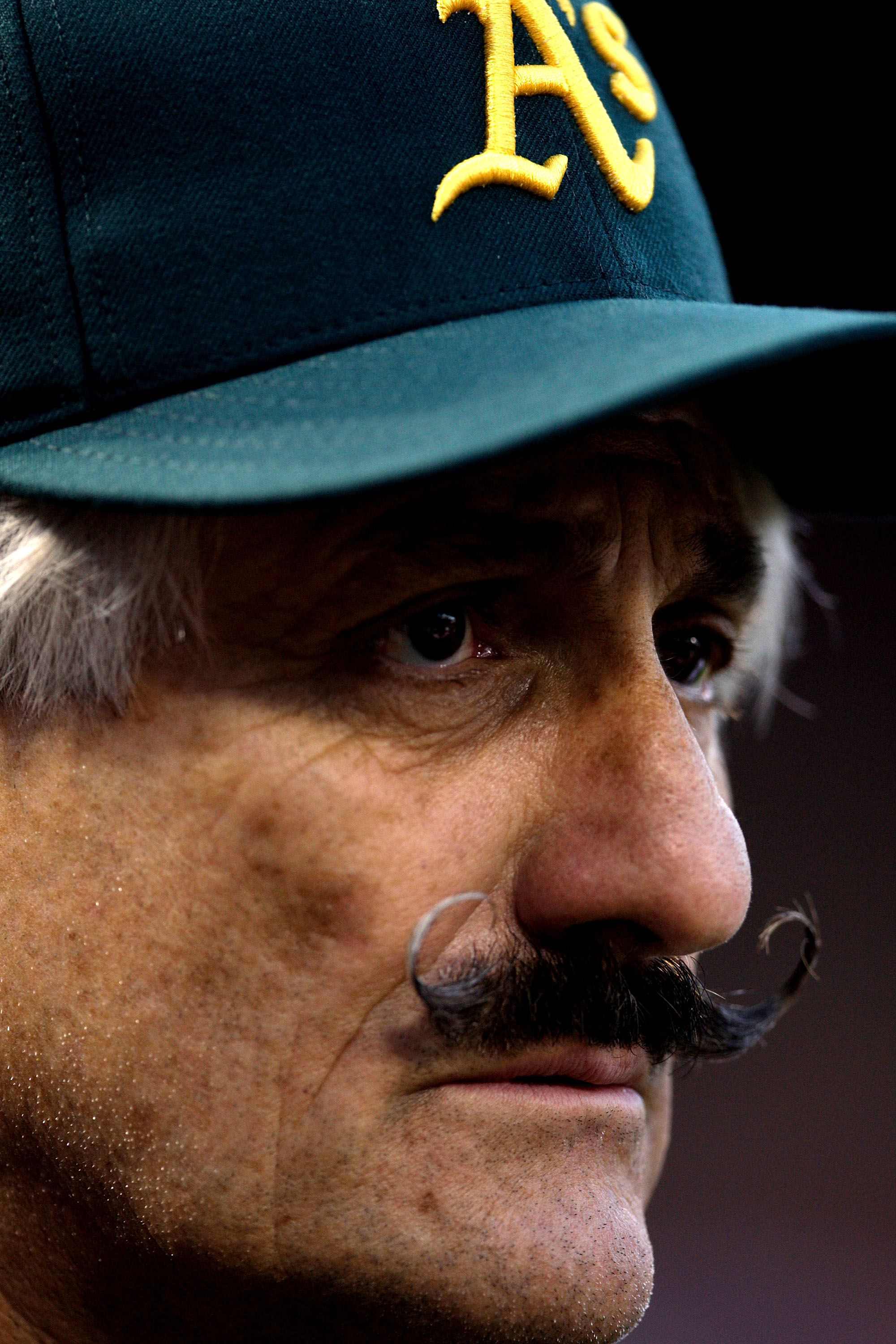 ST LOUIS, MO - JULY 12:  Hall of famer Rollie Fingers looks on during the Taco Bell All-Star Legends & Celebrity Softball Game at Busch Stadium on July 12, 2009 in St. Louis, Missouri.  (Photo by Jamie Squire/Getty Images)