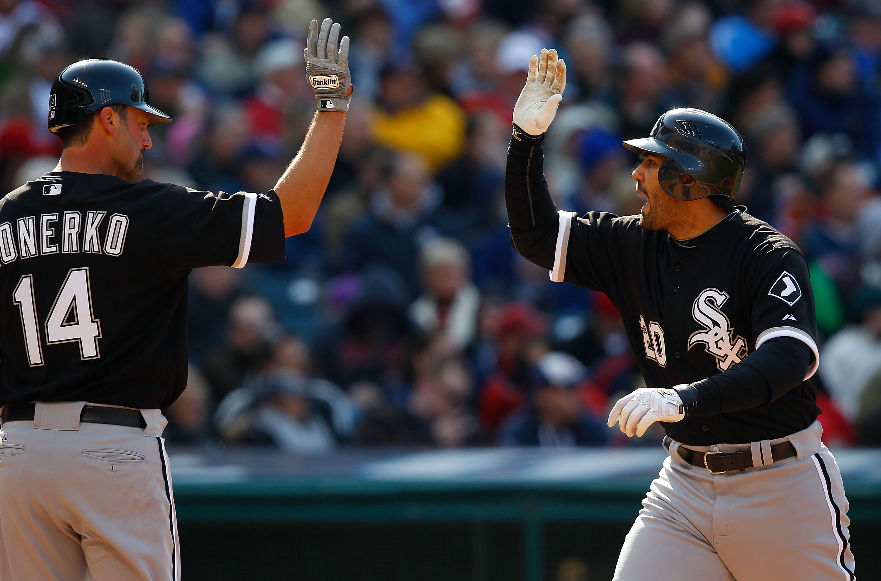 CLEVELAND - APRIL 01:  Carlos Quentin #20 celebrates with teammate aul Konerko #14 of the Chicago White Sox after hitting a two-run home run during the Opening Day game against the Cleveland Indians on April 1, 2011 at Progressive Field in Cleveland, Ohio