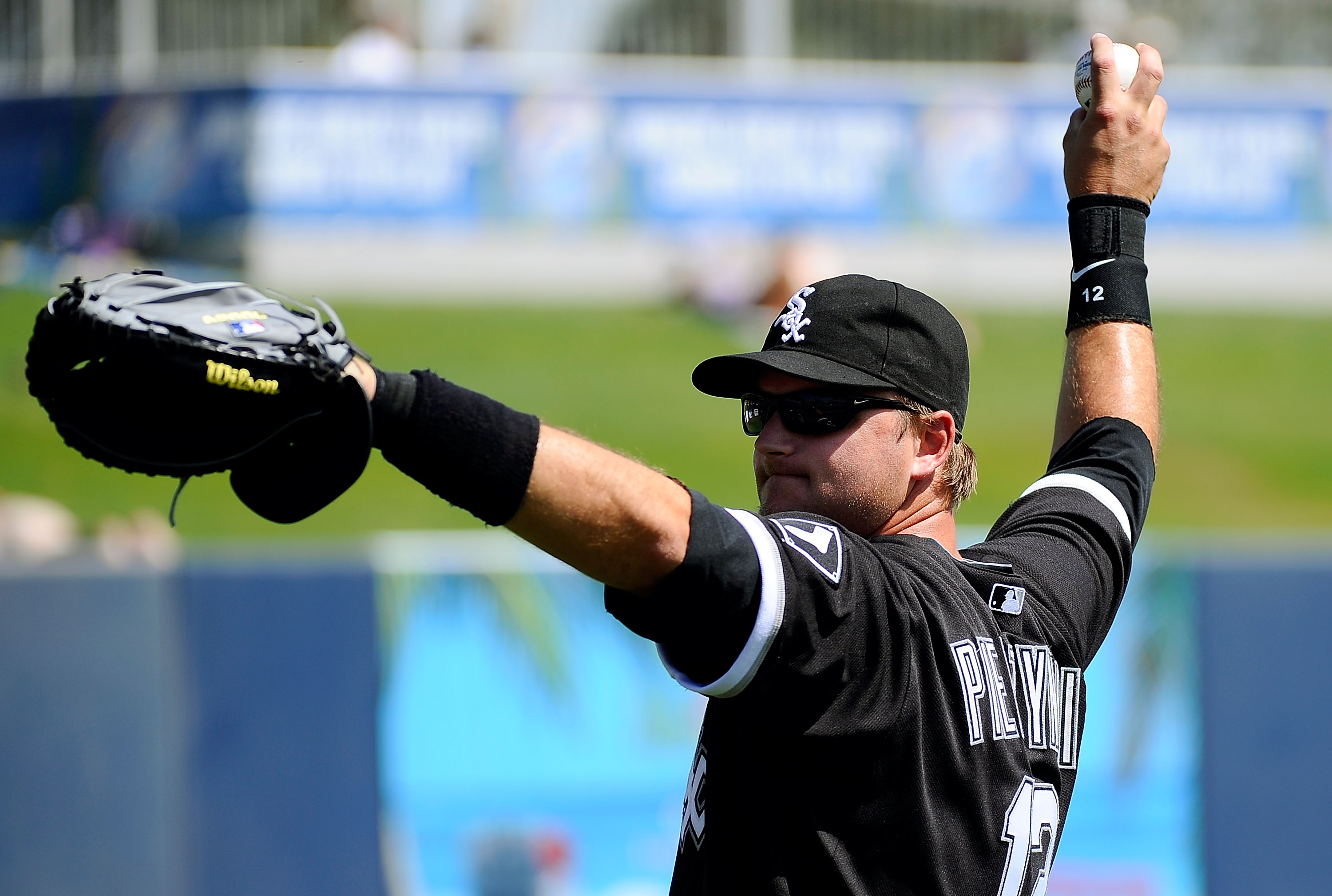 PHOENIX, AZ - MARCH 17:  A.J. Pierzynski #12 of the Chicago White Sox warms up on the field before playing against the Milwaukee Brewers during the spring training game at Maryvale Baseball Park on March 17, 2011 in Phoenix, Arizona.  (Photo by Kevork Dja