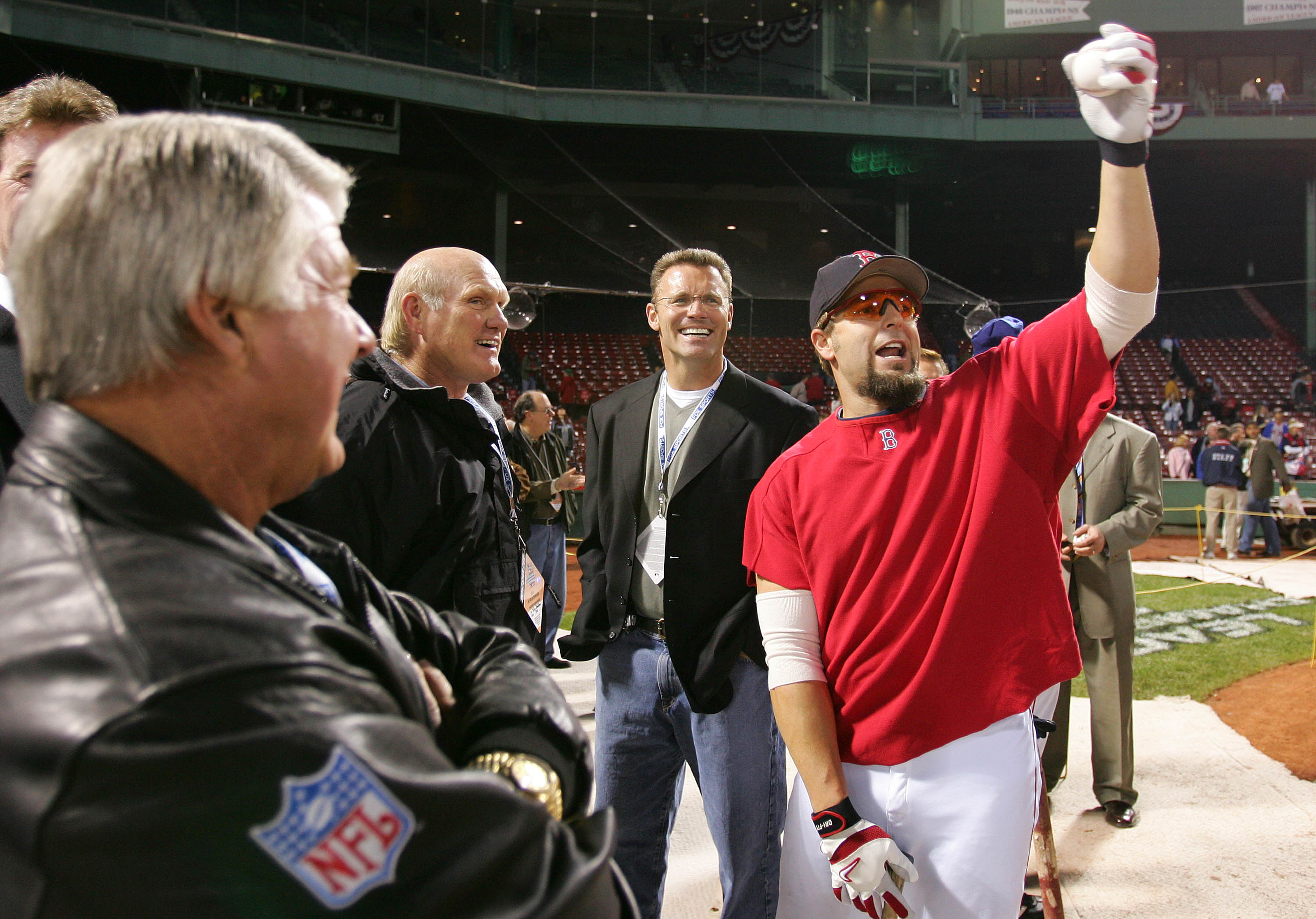 BOSTON - OCTOBER 16:  Kevin Millar #15 of the Boston Red Sox shares a laugh with Fox NFL television sportscasters, from left, Jimmy Johnson, Terry Bradshaw, and Howie Long before game three of the American League Championship Series against the New York Y
