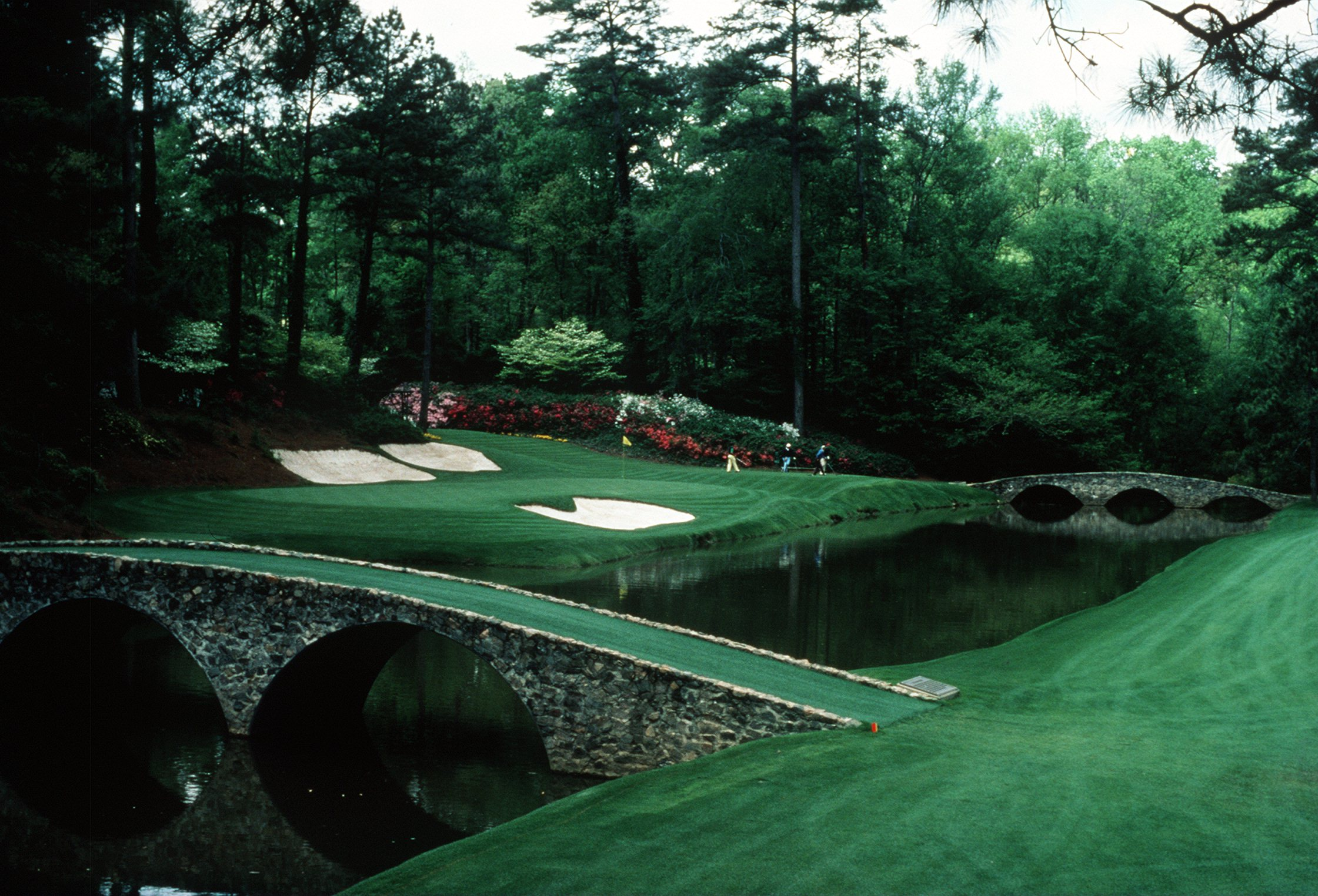 A SCENIC VIEW OF THE INFAMOUS AMEN CORNER OF THE PAR 3 12TH HOLE DURING THE 1992 MASTERS TOURNAMENT AT THE AUGUSTA NATIONAL GOLF COURSE IN AUGUSTA, GEORGIA.