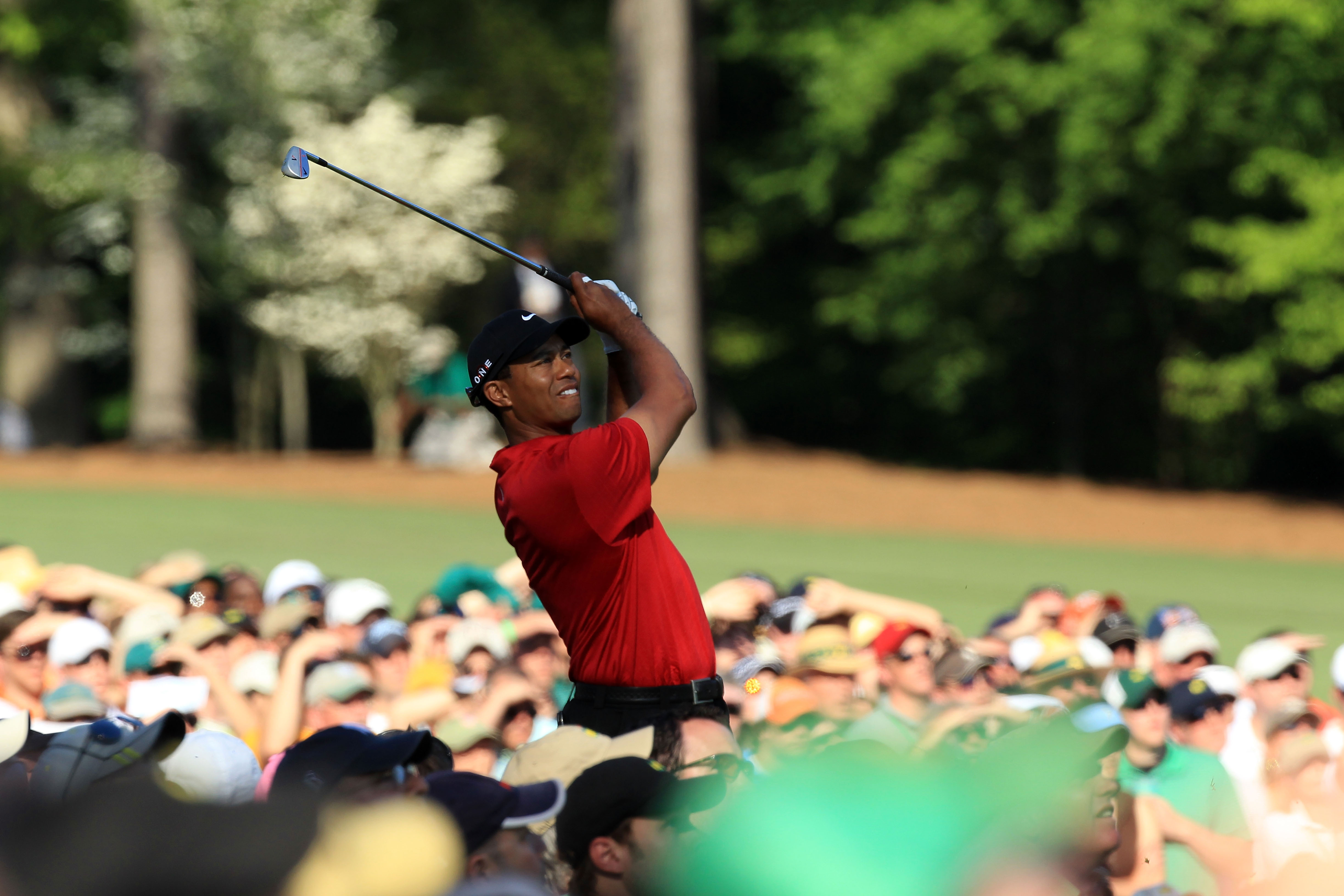 AUGUSTA, GA - APRIL 11:  Tiger Woods watches his tee shot on the 12th hole during the final round of the 2010 Masters Tournament at Augusta National Golf Club on April 11, 2010 in Augusta, Georgia.  (Photo by David Cannon/Getty Images)