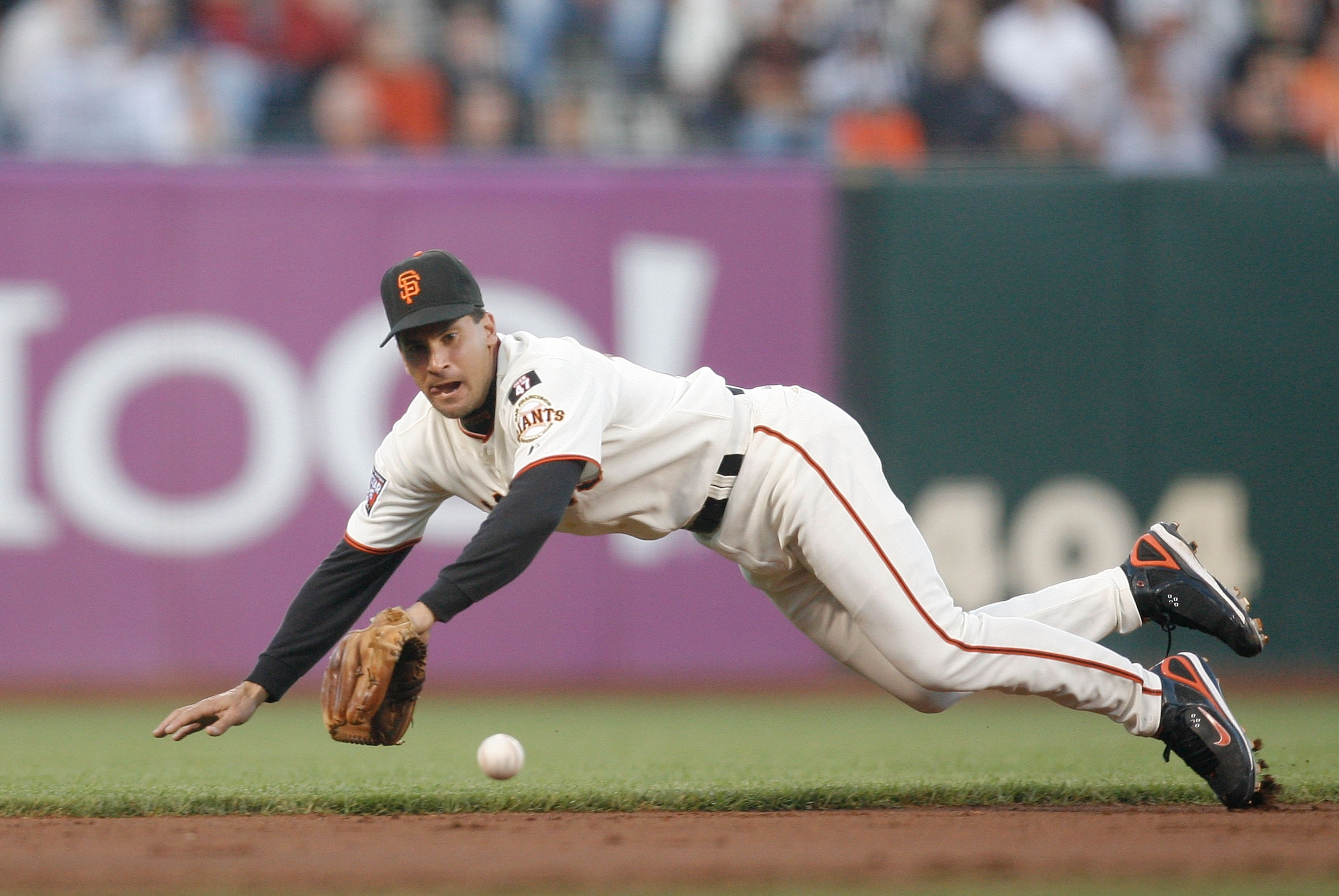 SAN FRANCISCO - AUGUST 21: Shortstop Omar Vizquel #13 of the San Francisco Giants dives for a groundball against the Chicago Cubs during a Major League Baseball game at AT&T Park on August 21, 2007 in San Francisco, California.  (Photo by Greg Trott/Getty