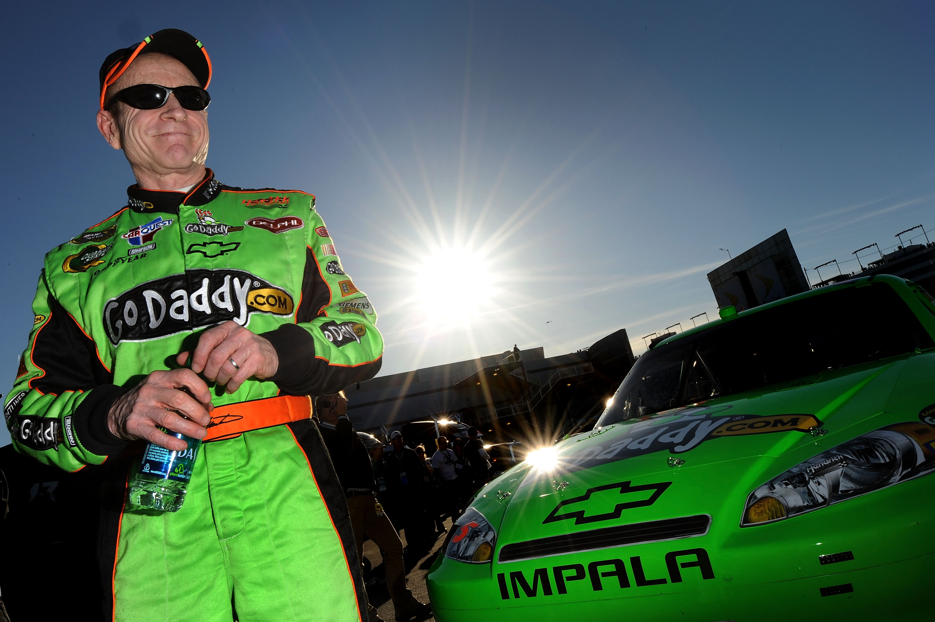LAS VEGAS, NV - MARCH 04:  Mark Martin, driver of the #5 GoDaddy.com Chevrolet, stands in the garage area after qualifying for the NASCAR Sprint Cup Series Kobalt Tools 400 at Las Vegas Motor Speedway on March 4, 2011 in Las Vegas, Nevada.  (Photo by Jare