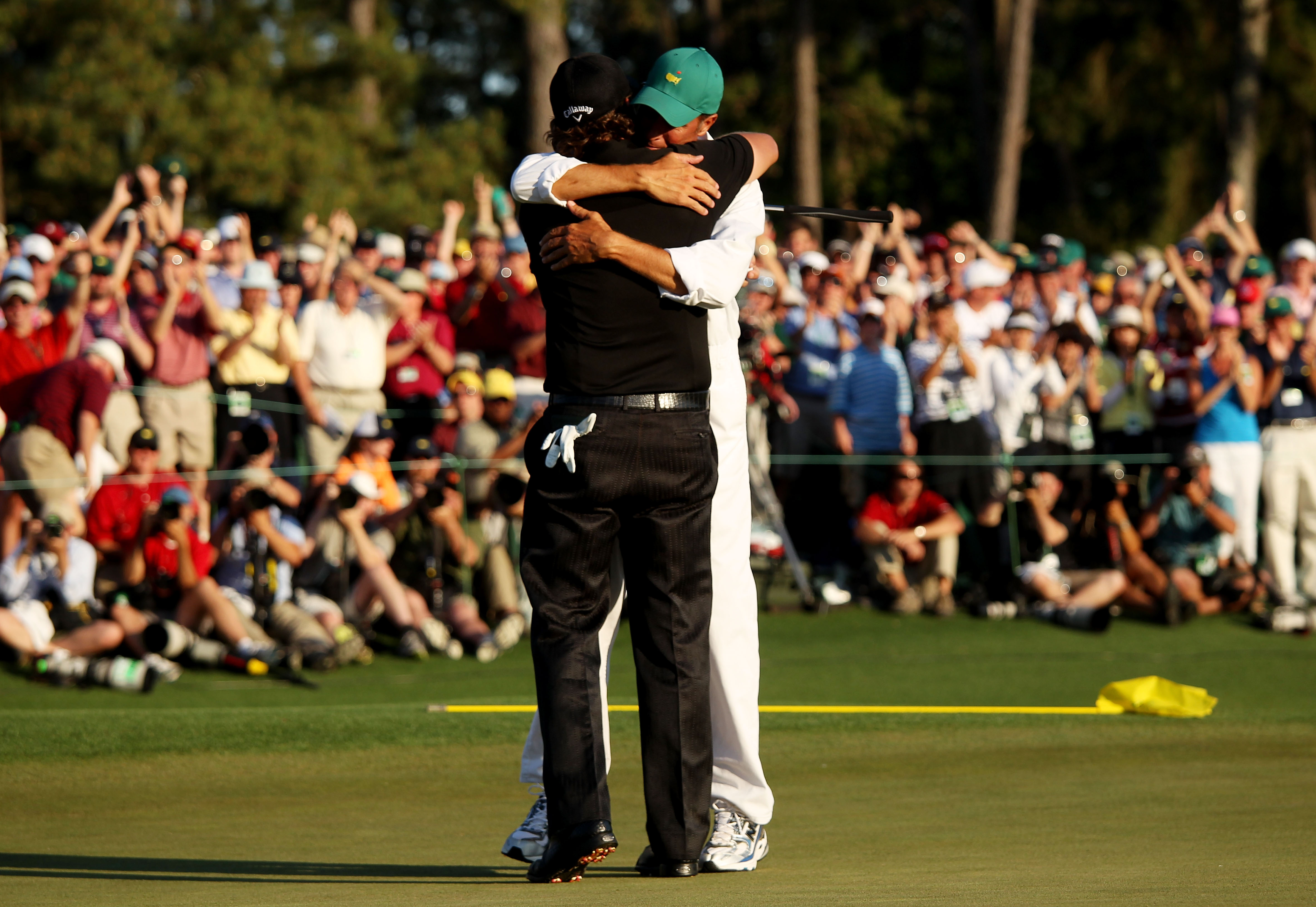 AUGUSTA, GA - APRIL 11:  Phil Mickelson celebrates with his caddie Jim Mackay after his three-stroke victory after winning the 2010 Masters Tournament at Augusta National Golf Club on April 11, 2010 in Augusta, Georgia.  (Photo by Andrew Redington/Getty I