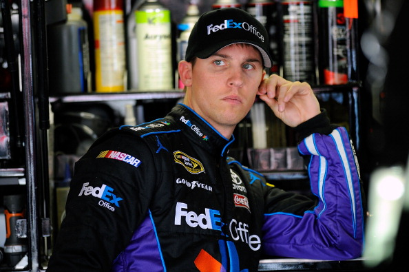 FONTANA, CA - MARCH 26:  Denny Hamlin, driver of the #11 FedEx Toyota, stands in the garage area during practice for the NASCAR Sprint Cup Series Auto Club 400 at Auto Club Speedway on March 26, 2011 in Fontana, California.  (Photo by Jared C. Tilton/Gett