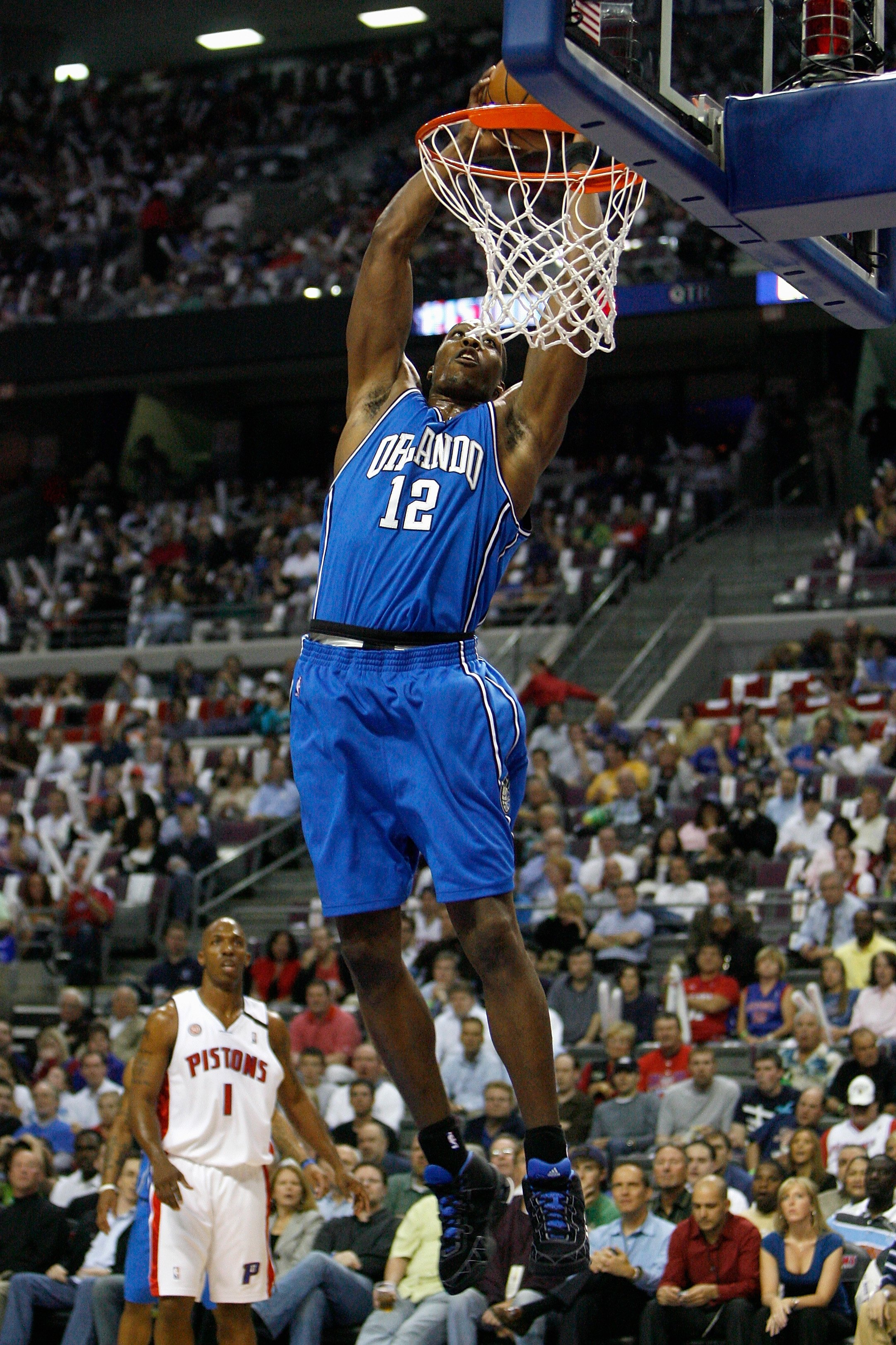 AUBURN HILLS, MI - MAY 5:  Dwight Howard #12 of the Orlando Magic slam dunks against the Detroit Pistons in Game Two of the Eastern Conference Semifinals during the 2008 NBA Playoffs on May 5, 2008 at the Palace of Auburn Hills in Auburn Hills, Michigan.