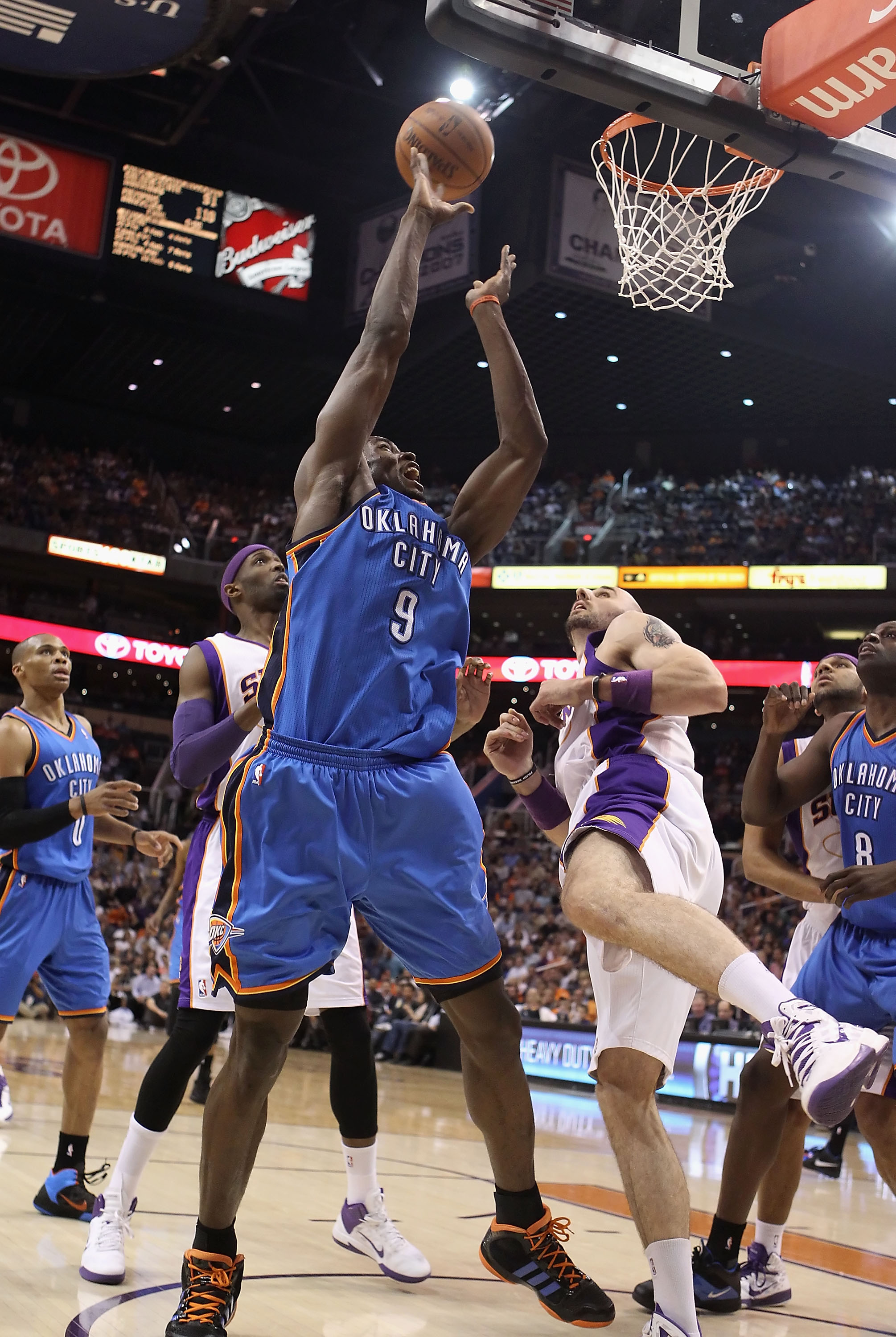 PHOENIX, AZ - MARCH 30:  Serge Ibaka #9 of the Oklahoma City Thunder puts up a shot during the NBA game against the Phoenix Suns at US Airways Center on March 30, 2011 in Phoenix, Arizona. The Thunder defeated the Suns 116-98.   NOTE TO USER: User express