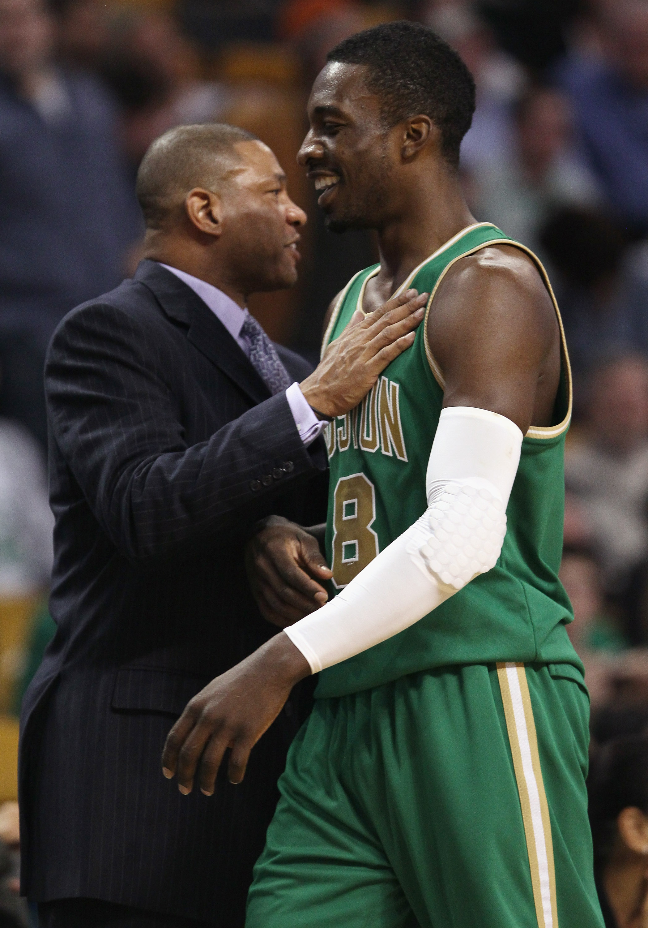 BOSTON, MA - MARCH 16:  Jeff Green #8 is congratulated by Doc Rivers of the Boston Celtics as Green is pulled from the game on March 16, 2011 at the TD Garden in Boston, Massachusetts. The Celtics defeated the Indiana Pacers 92-80. NOTE TO USER: User expr