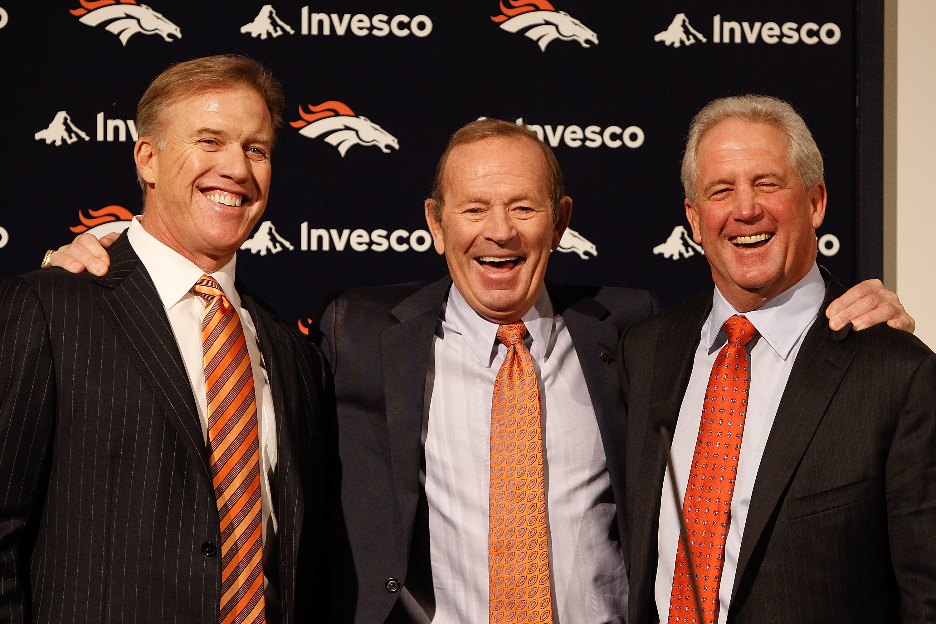 ENGLEWOOD, CO - JANUARY 14:  Denver Broncos vice president of football operations John Elway (L), owner Pat Bowlen and new head coach John Fox share a laugh before Fox addressed the media at Dove Valley on January 14, 2011 in Englewood, Colorado. Fox was