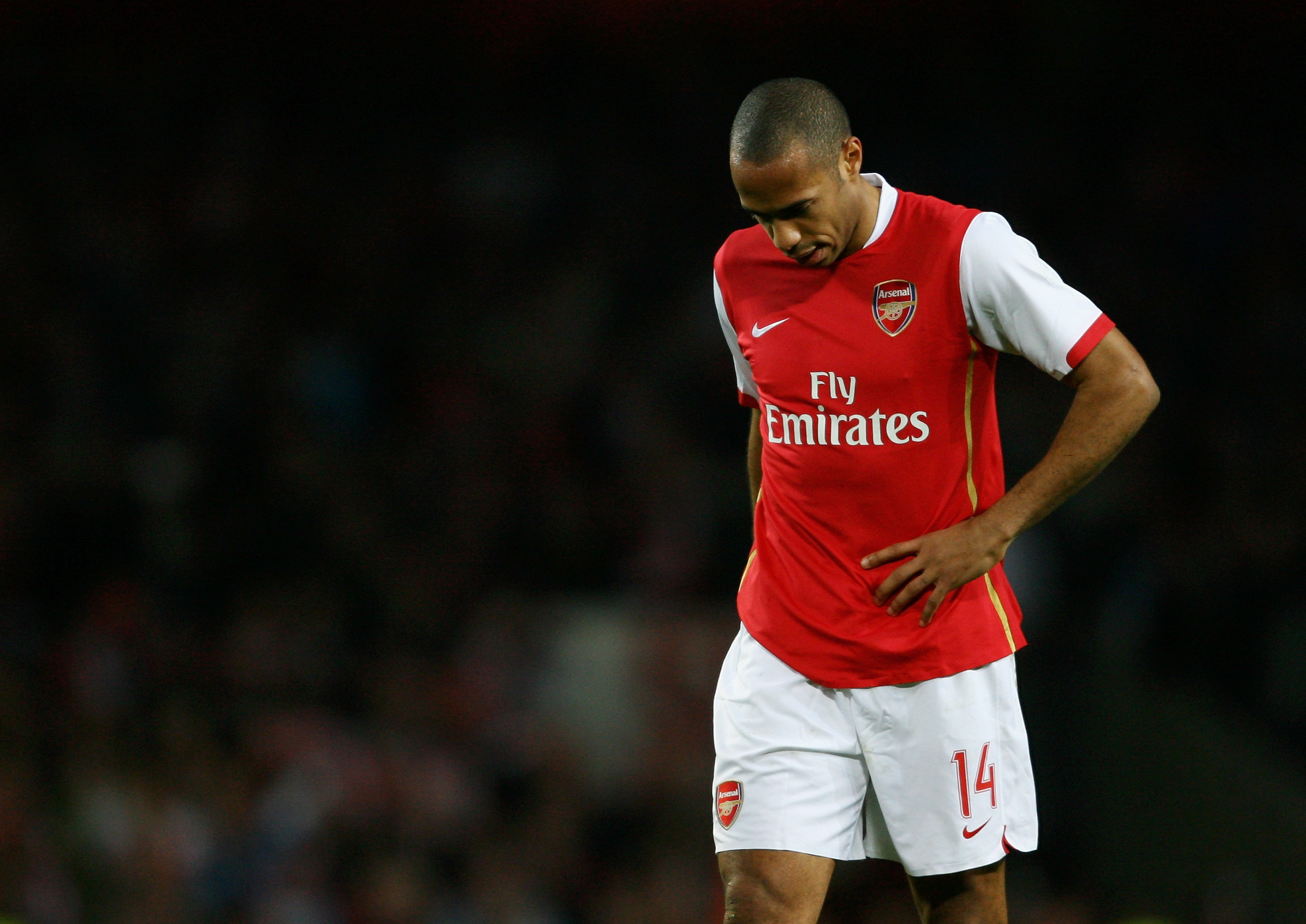 452ec992a9b LONDON - MARCH 07  A dejected Thierry Henry of Arsenal looks on as the final