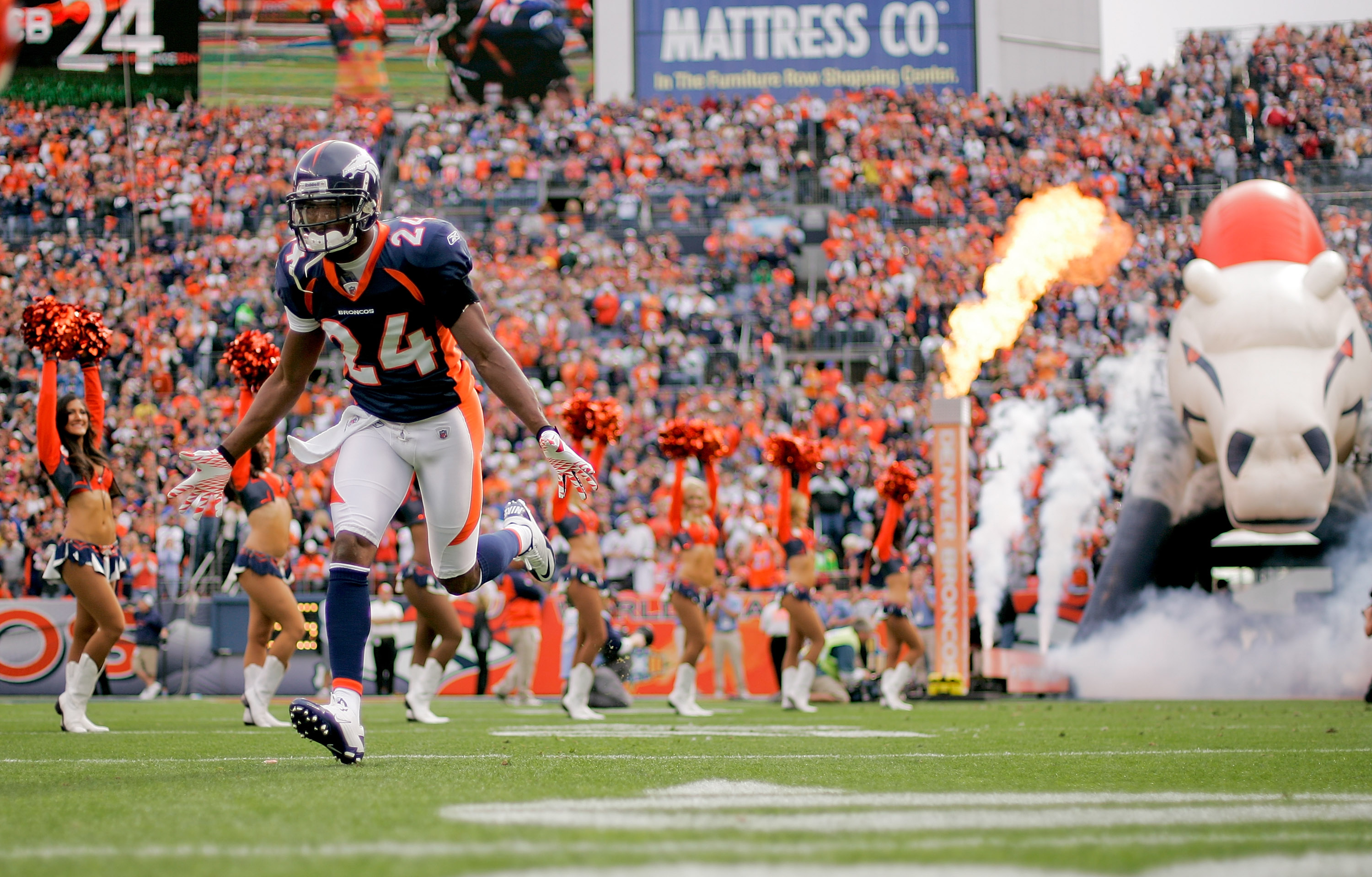 DENVER - OCTOBER 24:  Cornerback Champ Bailey #24 of the Denver Broncos runs onto the field before taking on the Oakland Raiders at INVESCO Field at Mile High on October 24, 2010 in Denver, Colorado. (Photo by Justin Edmonds/Getty Images)