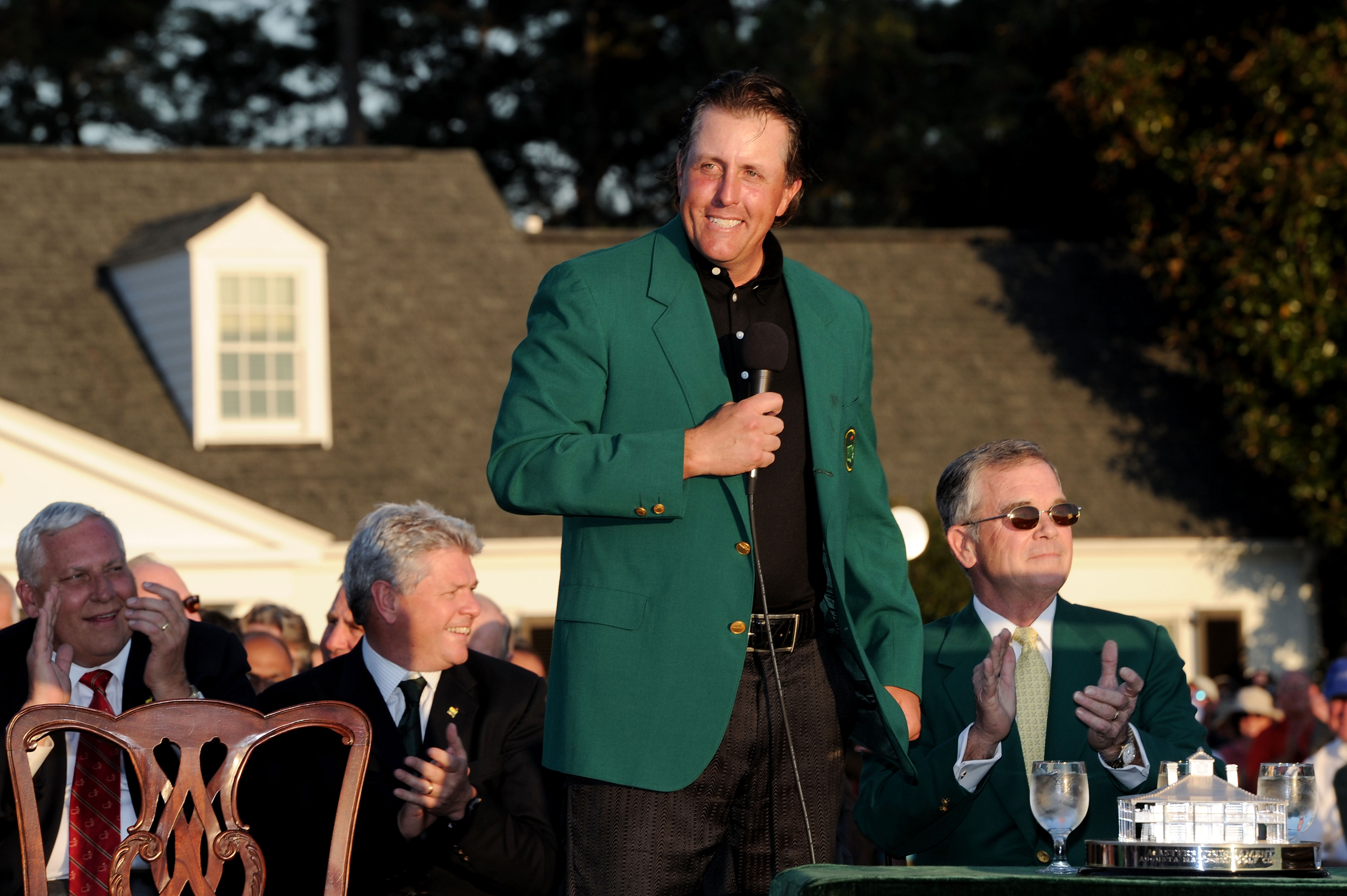 AUGUSTA, GA - APRIL 11:  Phil Mickelson speaks to the gallery as Augusta National Chairman William Porter 'Billy' Payne (R) looks on during the green jacket presentation after the final round of the 2010 Masters Tournament at Augusta National Golf Club on