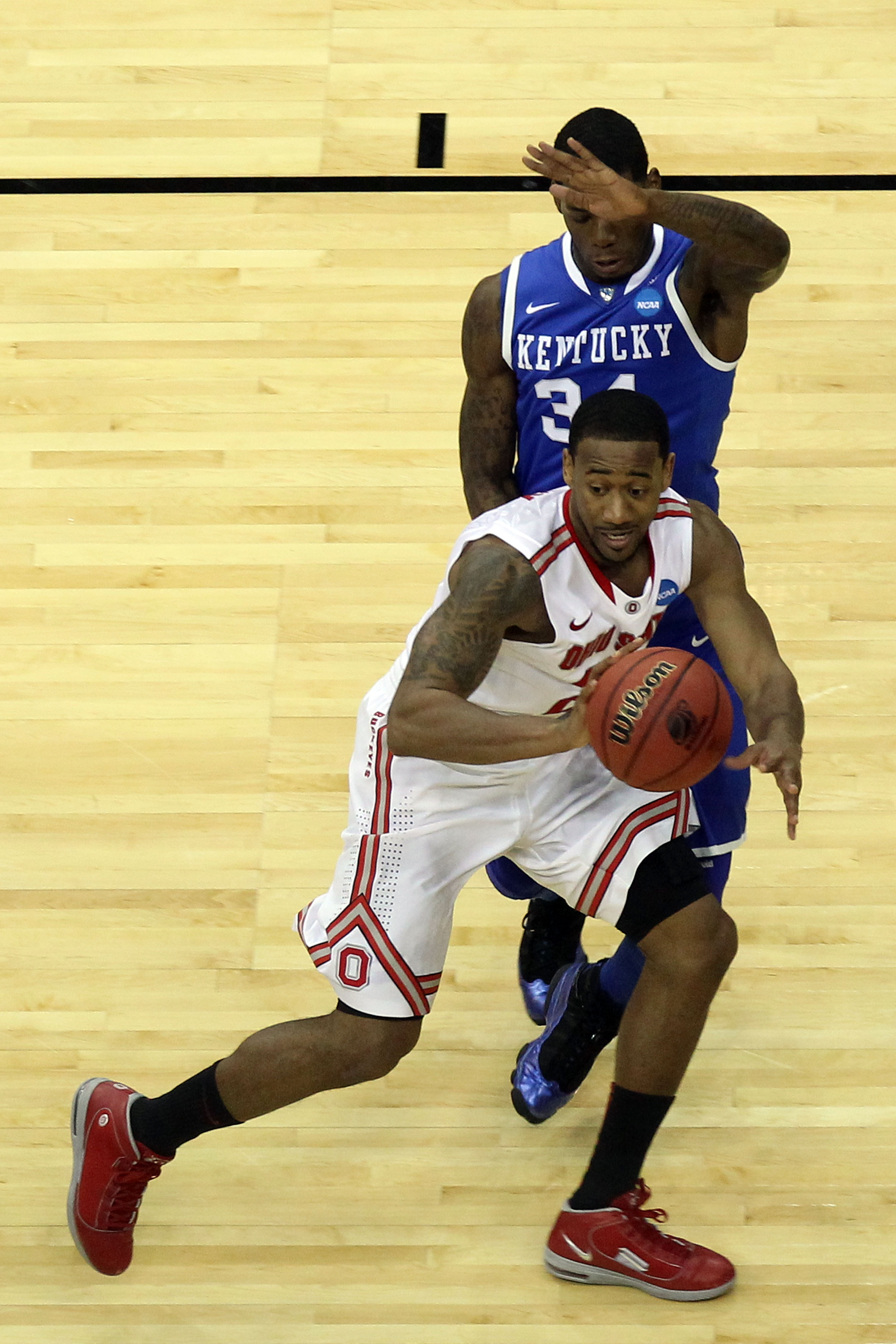 NEWARK, NJ - MARCH 25:  David Lighty #23 of the Ohio State Buckeyes in action against DeAndre Liggins #34 of the Kentucky Wildcats during the east regional semifinal of the 2011 NCAA Men's Basketball Tournament at the Prudential Center on March 25, 2011 i