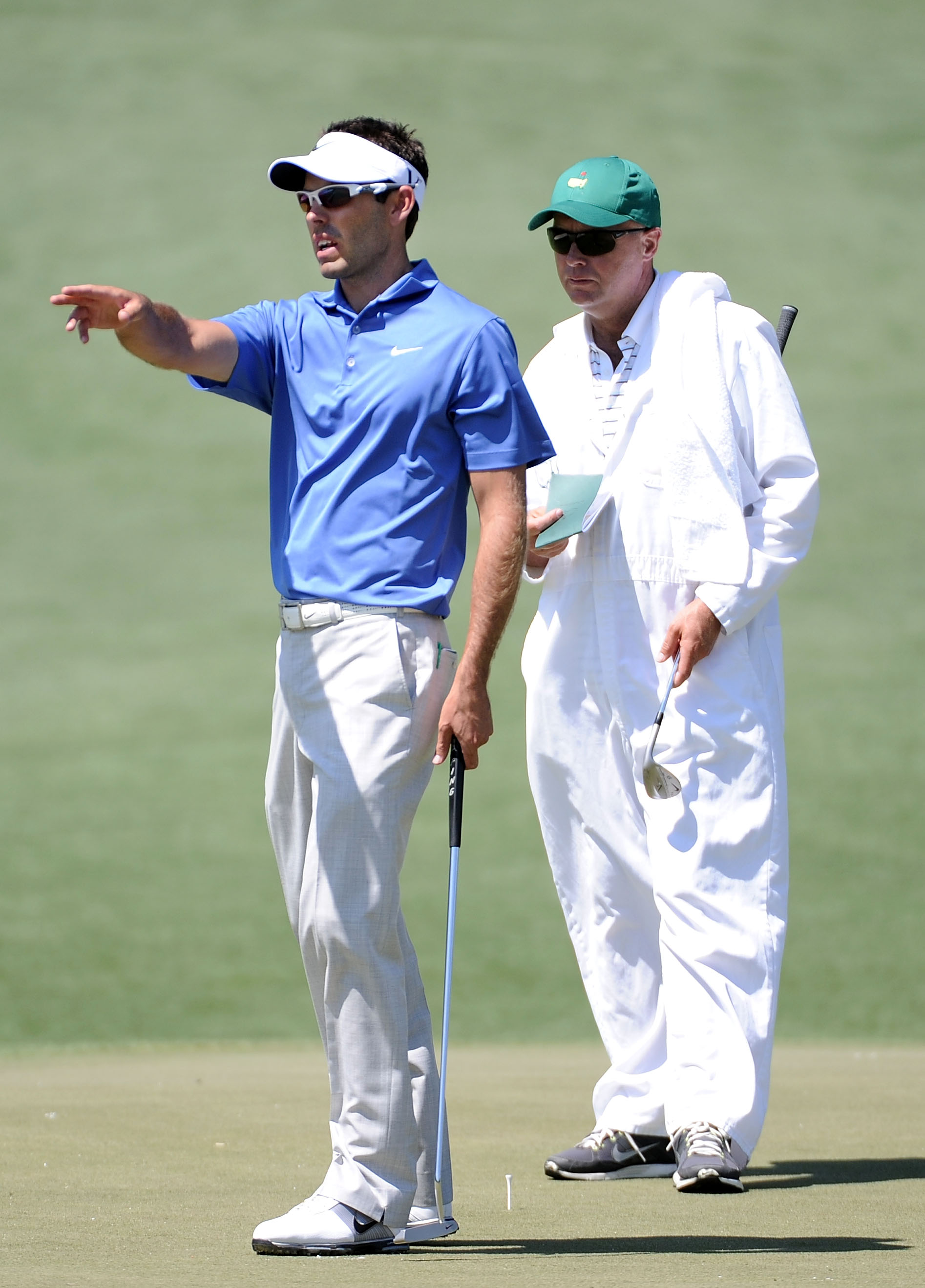 AUGUSTA, GA - APRIL 04:  Charl Schwartzel of South Africa chats with his caddie during a practice round prior to the 2011 Masters Tournament at Augusta National Golf Club on April 4, 2011 in Augusta, Georgia.  (Photo by Harry How/Getty Images)