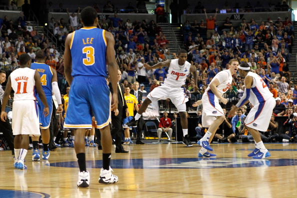 TAMPA, FL - MARCH 19:  Kenny Boynton #1, Erik Murphy #33 and Alex Tyus #23 of the Florida Gators react as Malcolm Lee #3 of the UCLA Bruins walks back to the bench during a timeout late in the second half during the third round of the 2011 NCAA men's bask