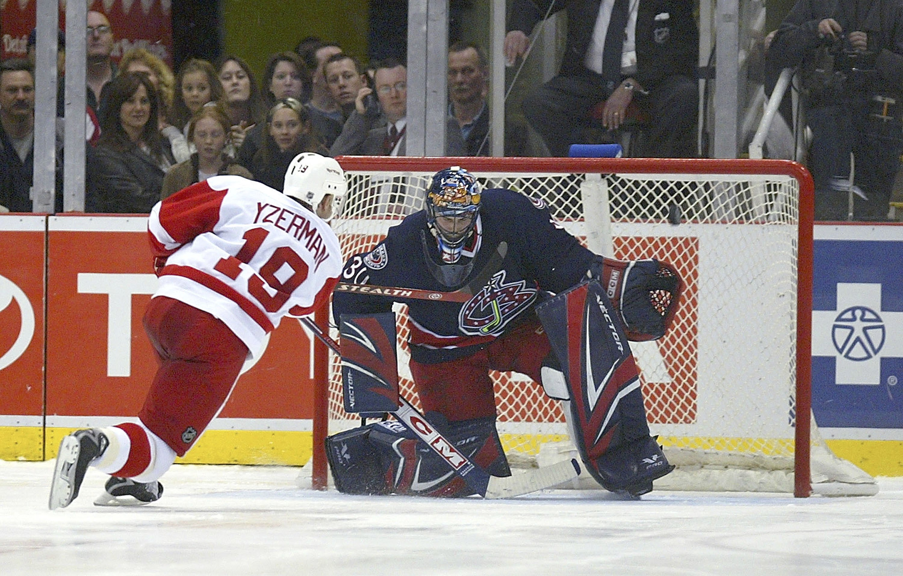 DETROIT - APRIL 7:  Steve Yzerman #19 of the Detroit Red Wings rings a shot off the crossbar against Marc Denis #30 of the Columbus Blue Jackets during their shootout at Joe Louis Arena on April 7, 2006 in Detroit, Michigan. The Red Wings defeated the Blu