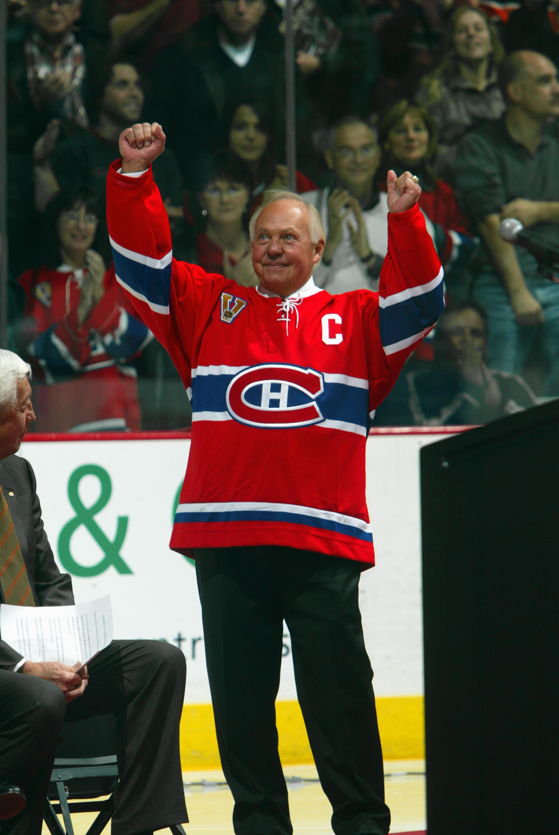 MONTREAL, CANADA - NOVEMBER 12:  Hall of Famer Yvan Cournoyer of the Montreal Canadiens acknowledges the crowd during a ceremony to retire the #12 in honor of Cournoyer and fellow Hall of Famer Dickie Moore before the NHL game against the Toronto Maple Le