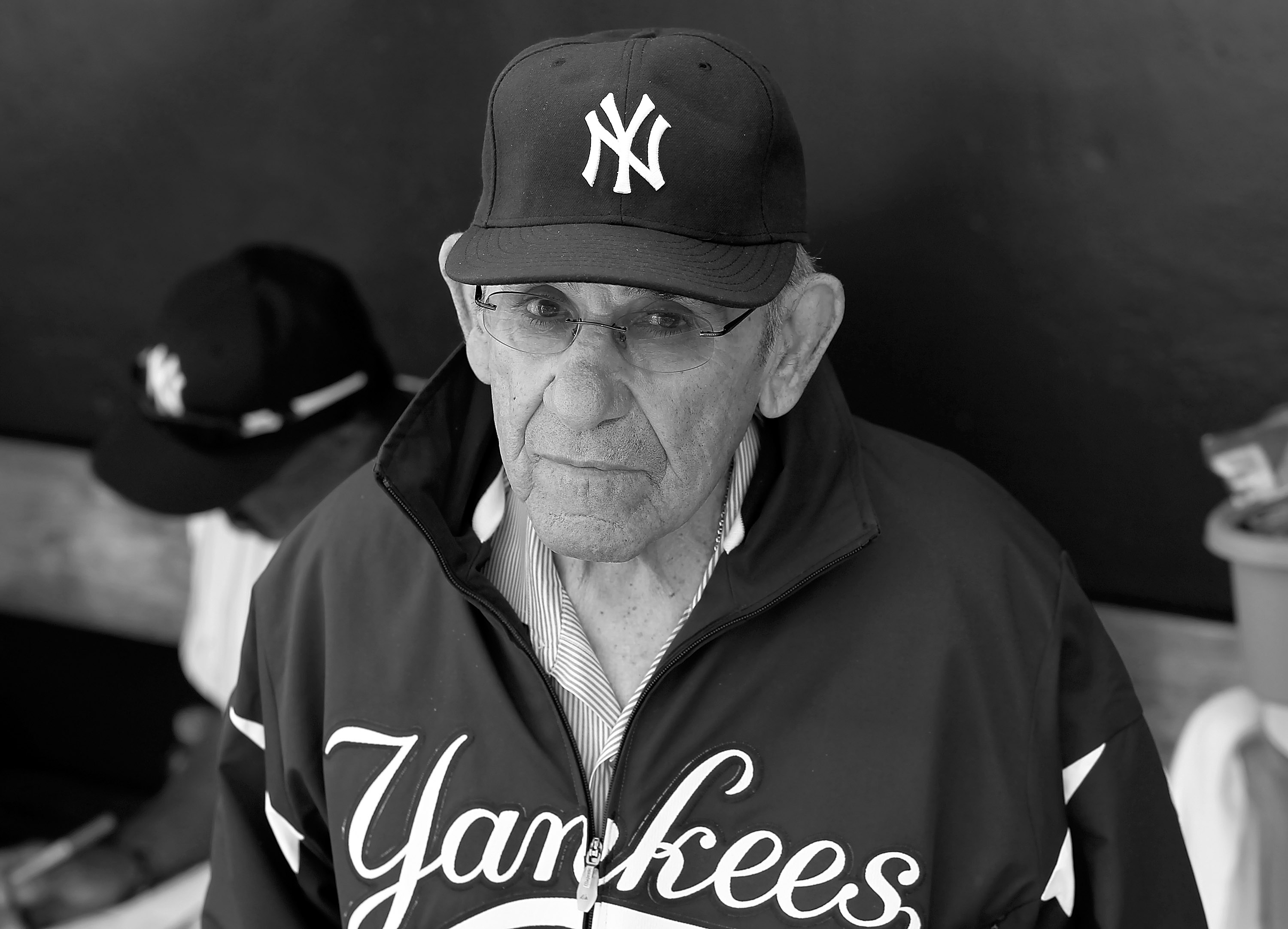 TAMPA, FL - FEBRUARY 26:  (EDITORS NOTE: Image has been converted to black and white.)  Hall of Famer Yogi Berra of the New York Yankees stands in the dugout just prior to the start of the Grapefruit League Spring Training Game against the Philadelphia Ph