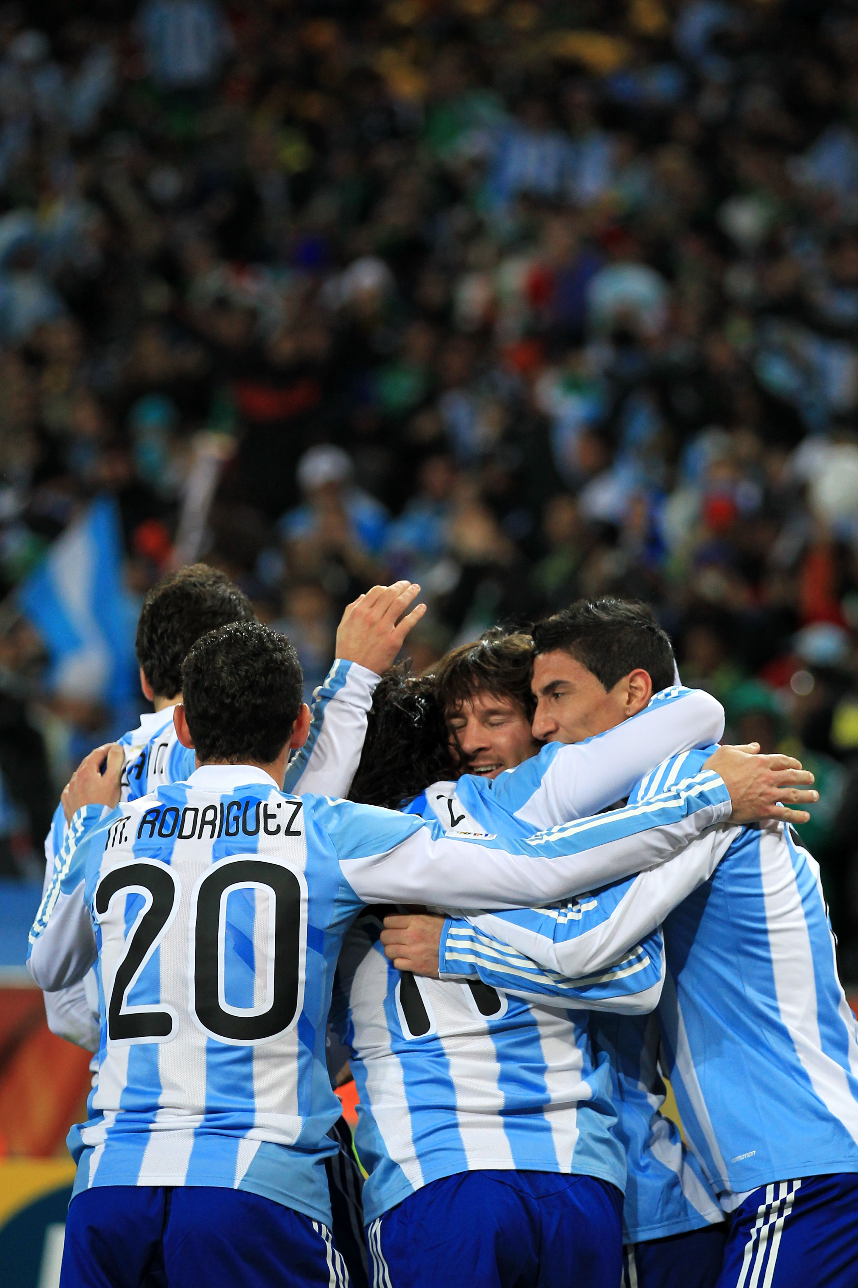 JOHANNESBURG, SOUTH AFRICA - JUNE 27:  Lionel Messi of Argentina (C) hugs goalscorer Carlos Tevez as they celebrate the opening goal during the 2010 FIFA World Cup South Africa Round of Sixteen match between Argentina and Mexico at Soccer City Stadium on