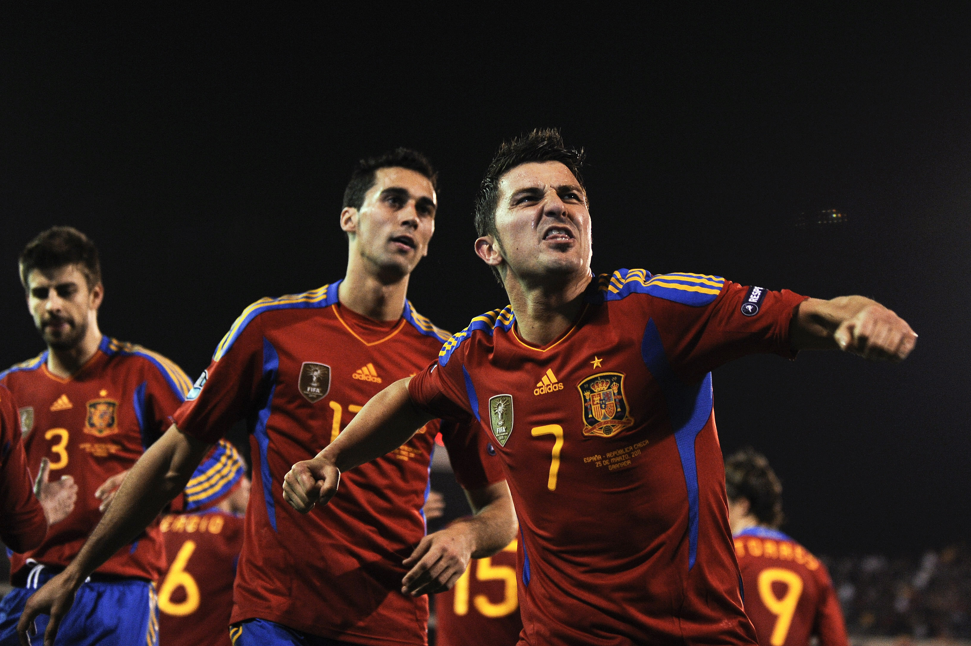 GRANADA, SPAIN - MARCH 25:  David Villa (R) of Spain celebrates after scoring his second goal during the UEFA EURO 2012 qualifier between Spain and Czech Republic at Los Carmenes Stadium on March 25, 2011 in Granada, Spain.  Spain win 2-1. (Photo by David