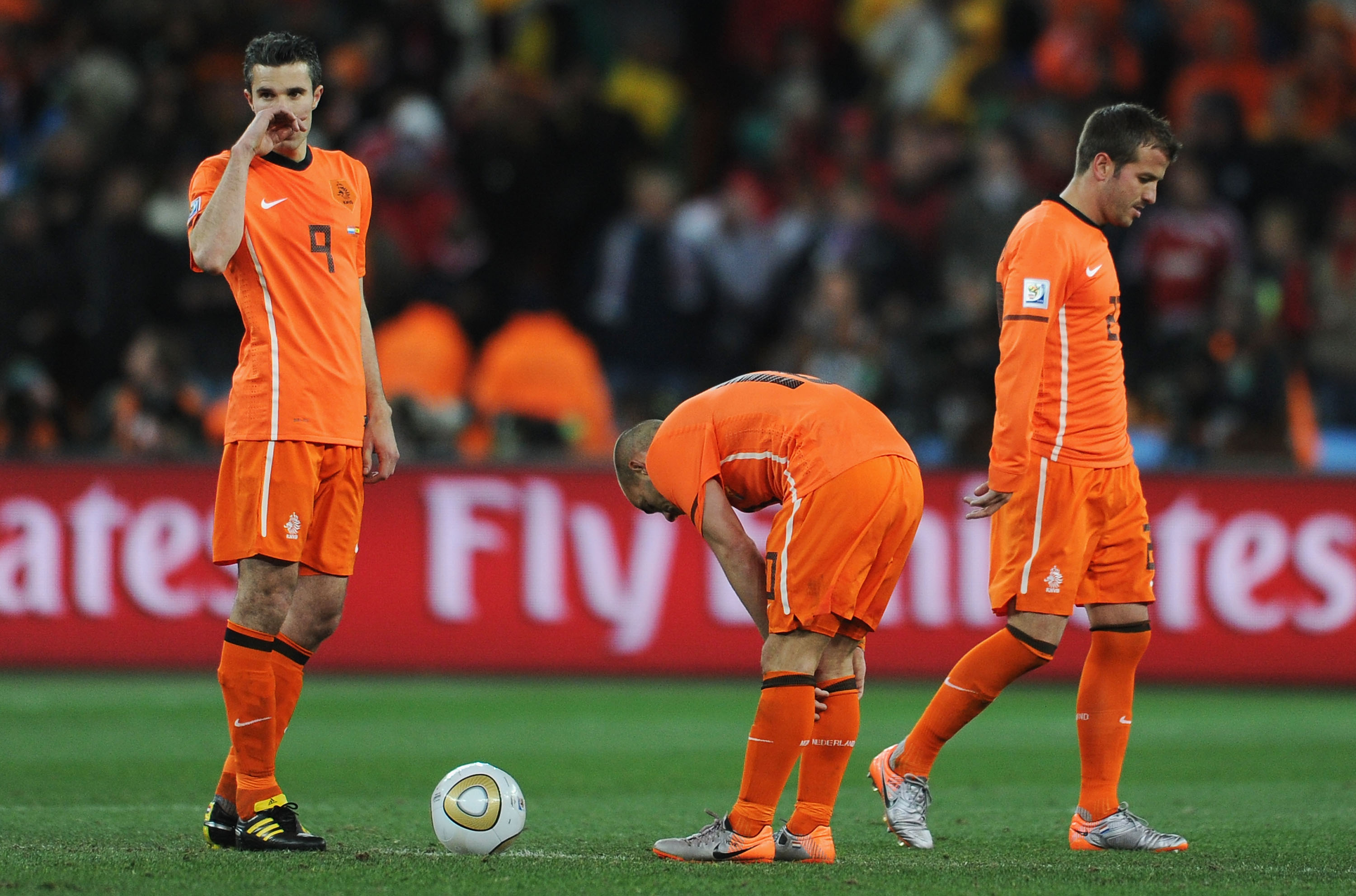 JOHANNESBURG, SOUTH AFRICA - JULY 11: Robin Van Persie, Wesley Sneijder and Rafael Van der Vaart of the Netherlands prepare to restart the match following a late Spain goal during the 2010 FIFA World Cup South Africa Final match between Netherlands and Sp